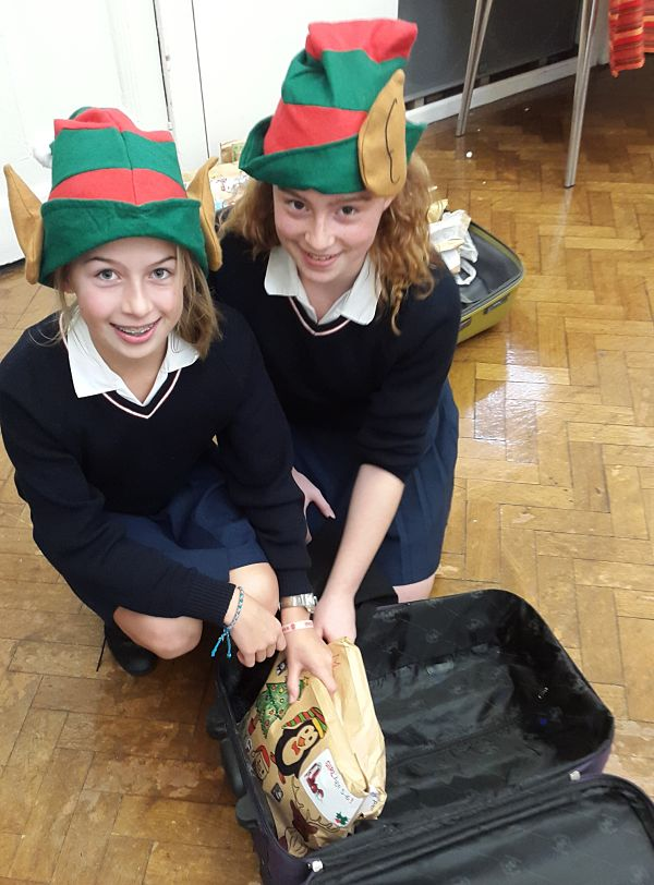 Elves packing a suitcase