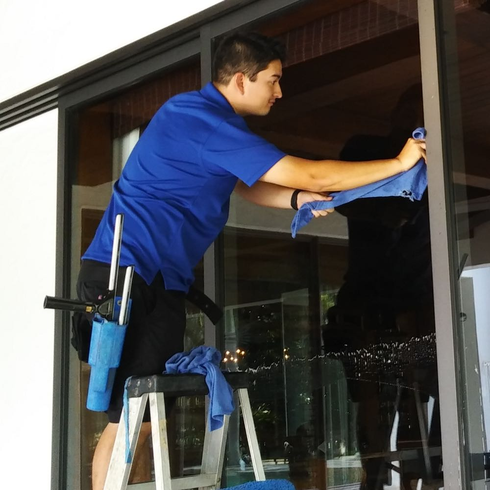 Windows being cleaned by window cleaning crew in Orlando FL