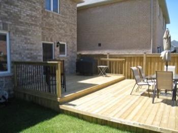 backyard deck with railing