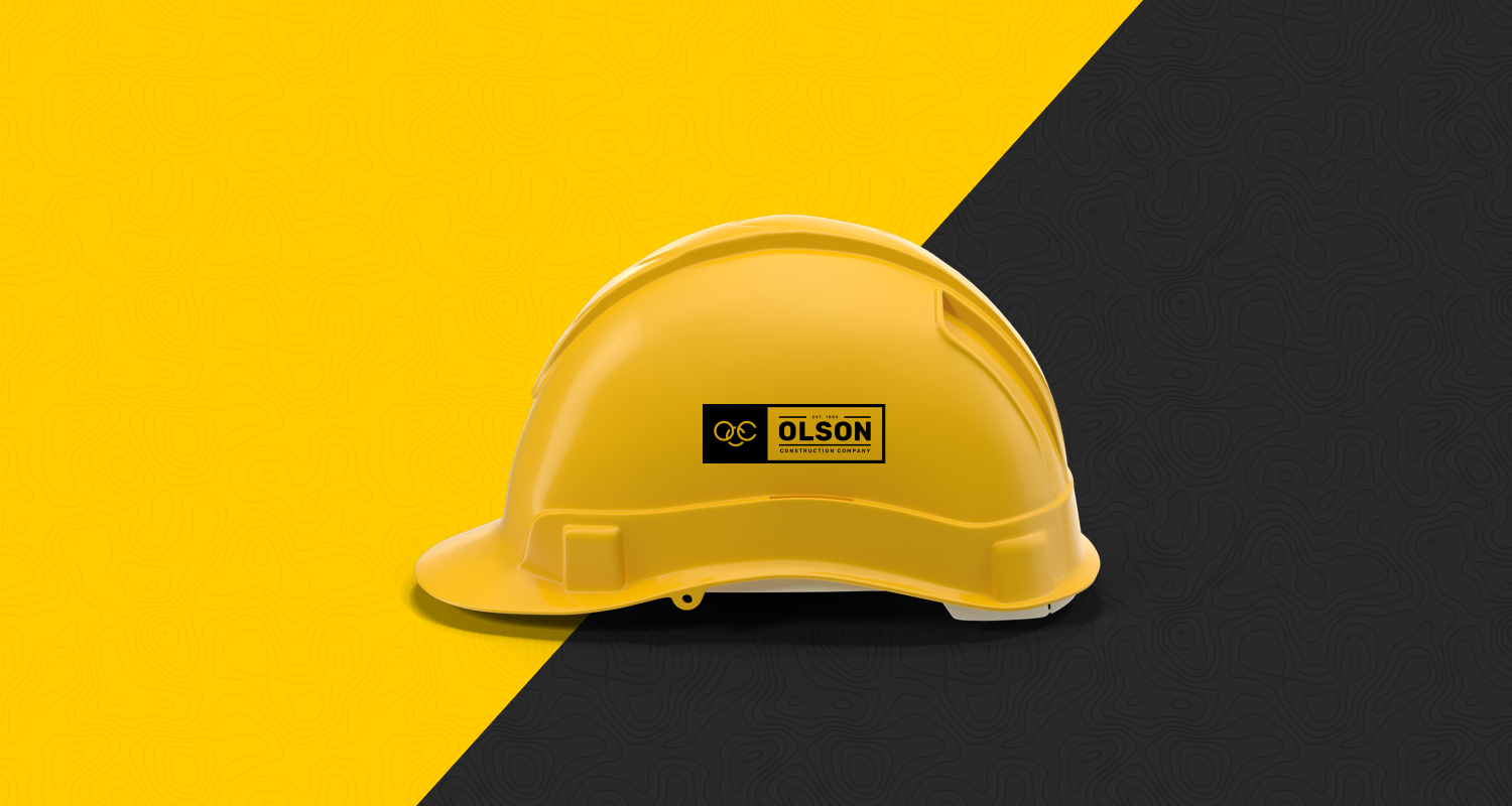 Final logo for Olson Construction Company presented on a hard hat for crew members