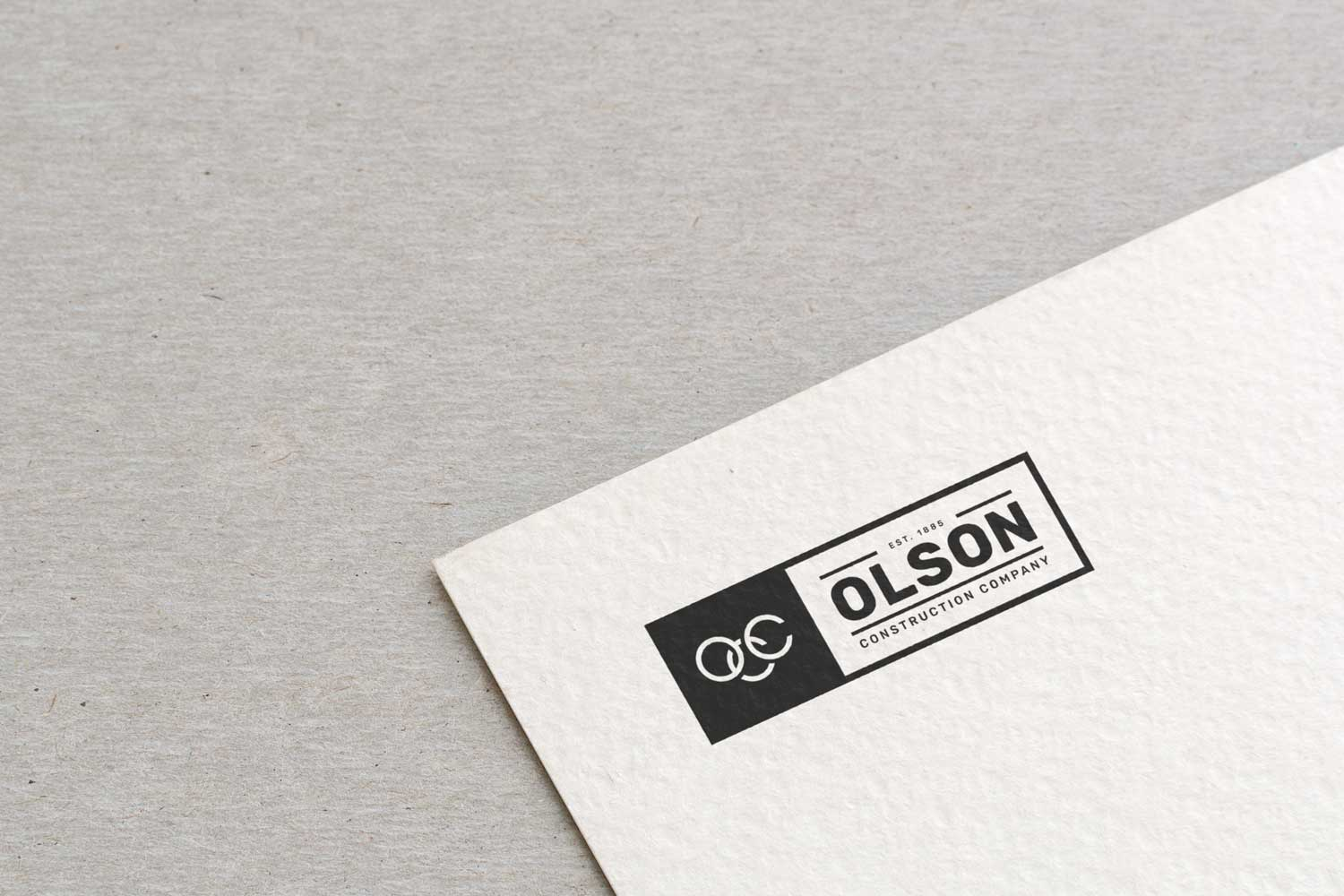 Final logo for Olson Construction Company presented on letterhead