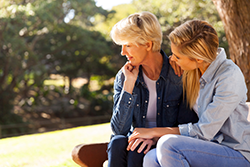 Mother and daughter discussing hearing loss