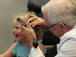 Dr. Saylor Examines Young Patient