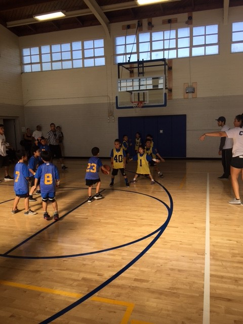 Kids playing basketball in our Tiny Eagles program.