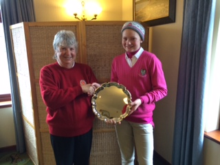 Winner Hannah Riddell (Royal Dornoch) receiving her trophy from County Captain Mrs Elizabeth Coghill