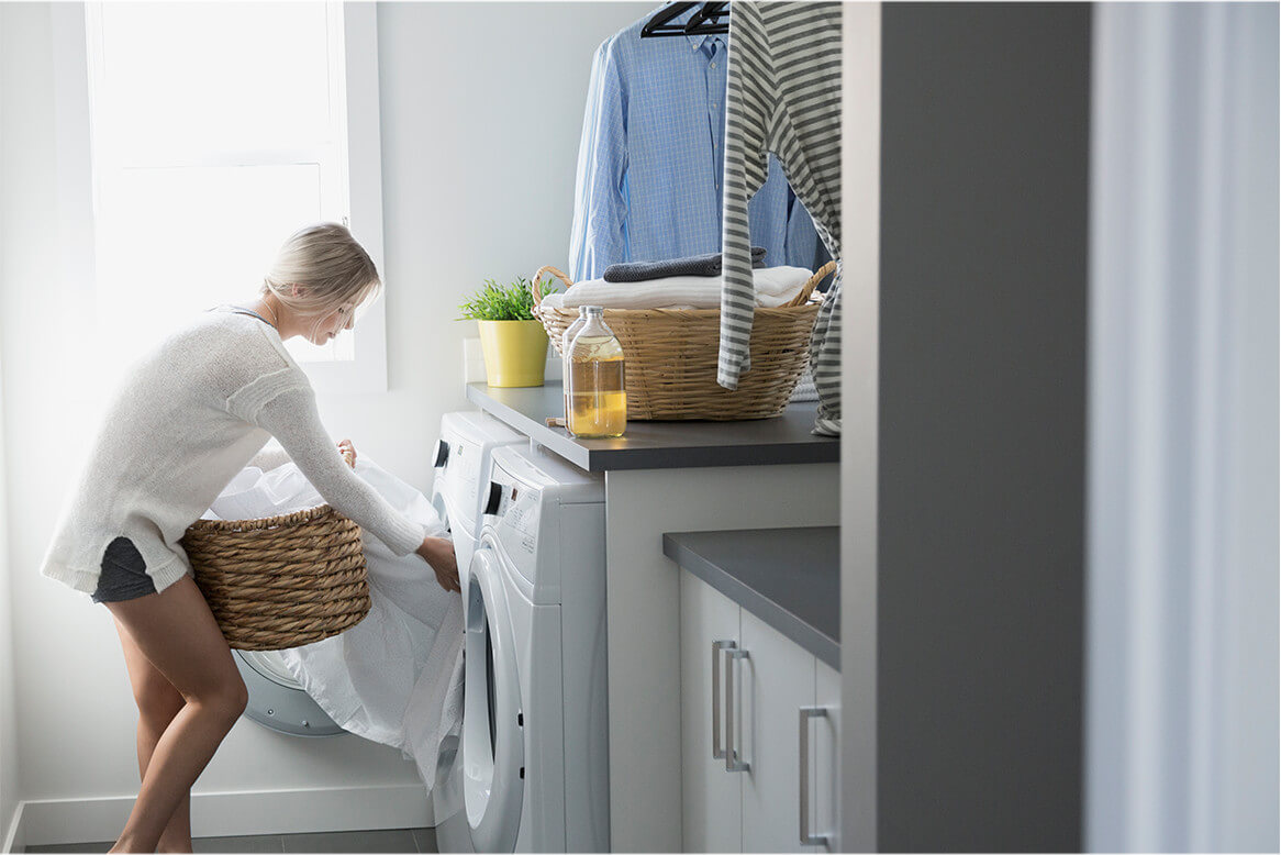 Woman removing towels from washer