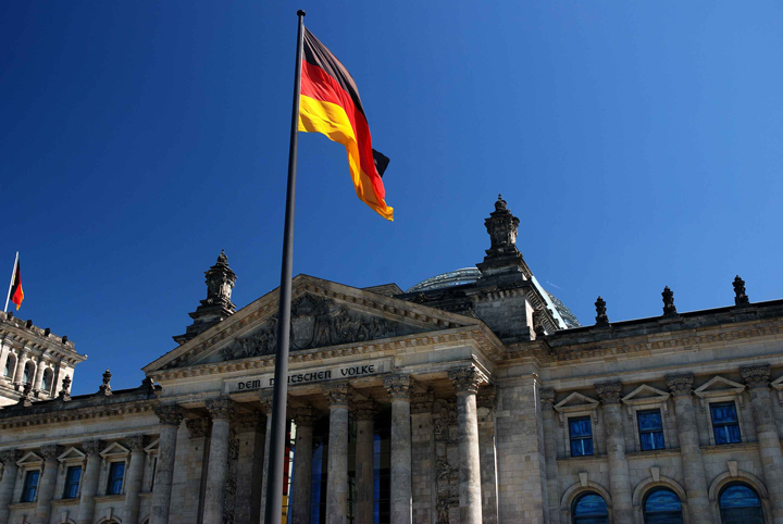 The German flag flies in front of the Bundestag, the national parliament of Germany. Photo by Thomas Ormston, licensed under CC BY-NC-ND 2.0.