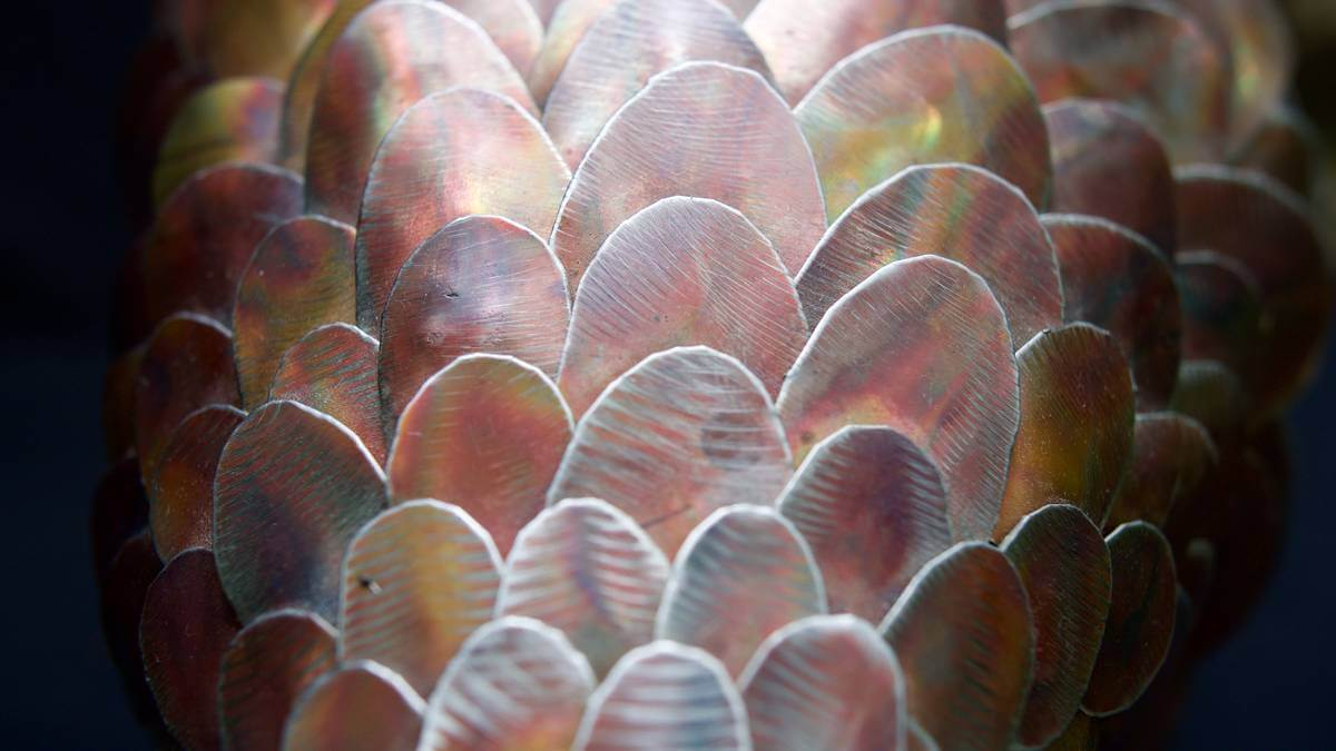 Detailed scale close up from metal pangolin sculpture.