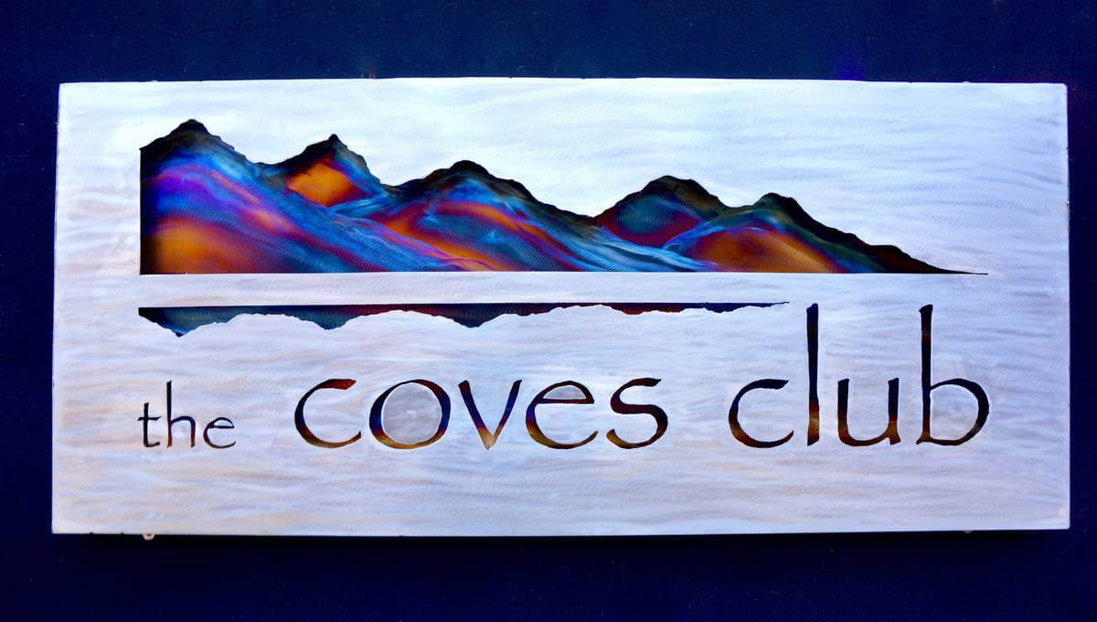 Metal coves club sign