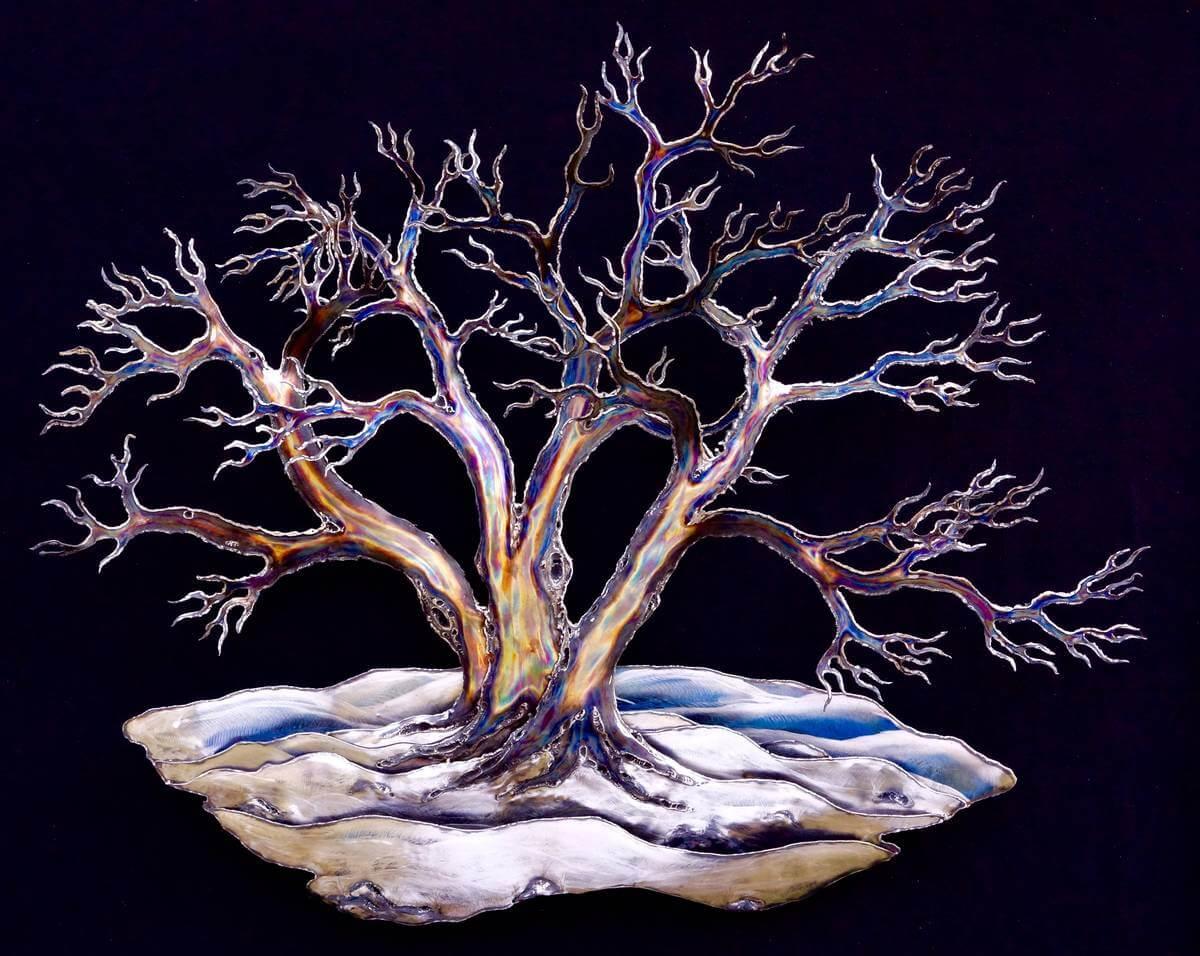 Metal snow laden tree sculpture