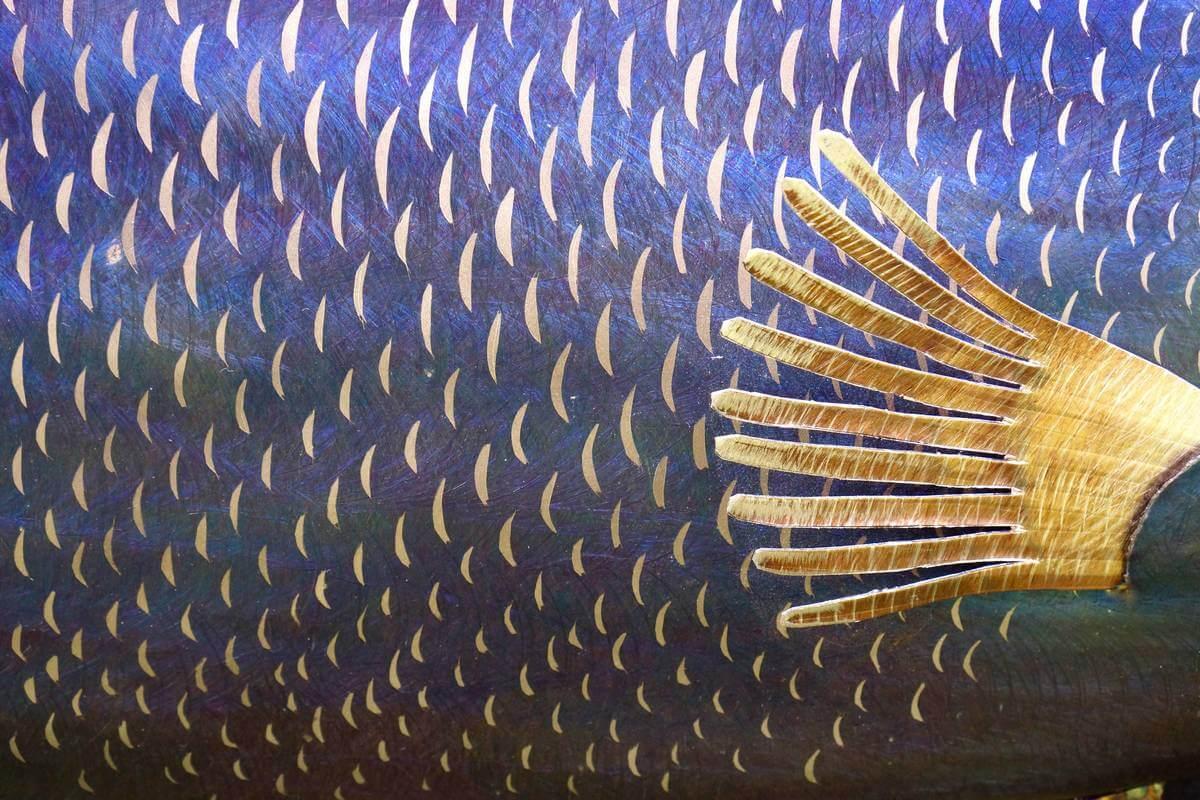 Close up of scales of metal saltwater angelfish sculpture