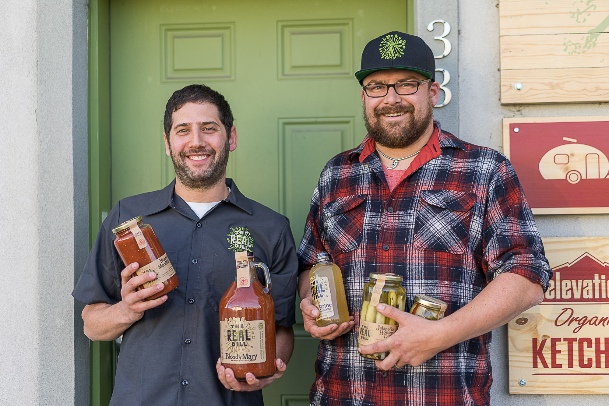 Co Founders of the Real Dill hold pickle jars in Denver.