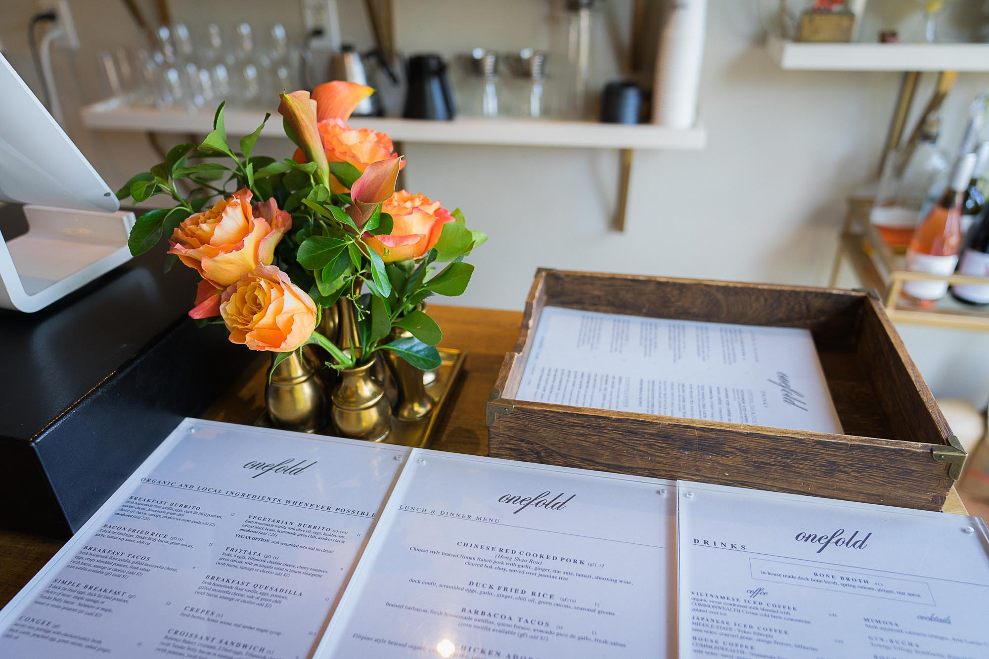 Menus sit on a tablr at Onefold in Denver