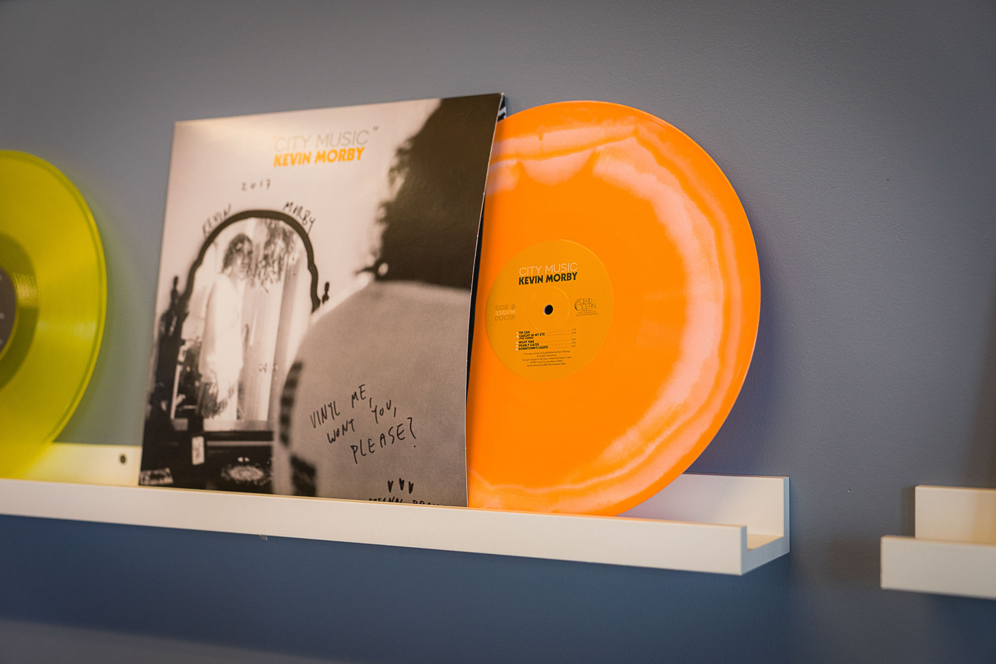 A Kevin Morby album sits on the wall at Vinyl Me, Please.