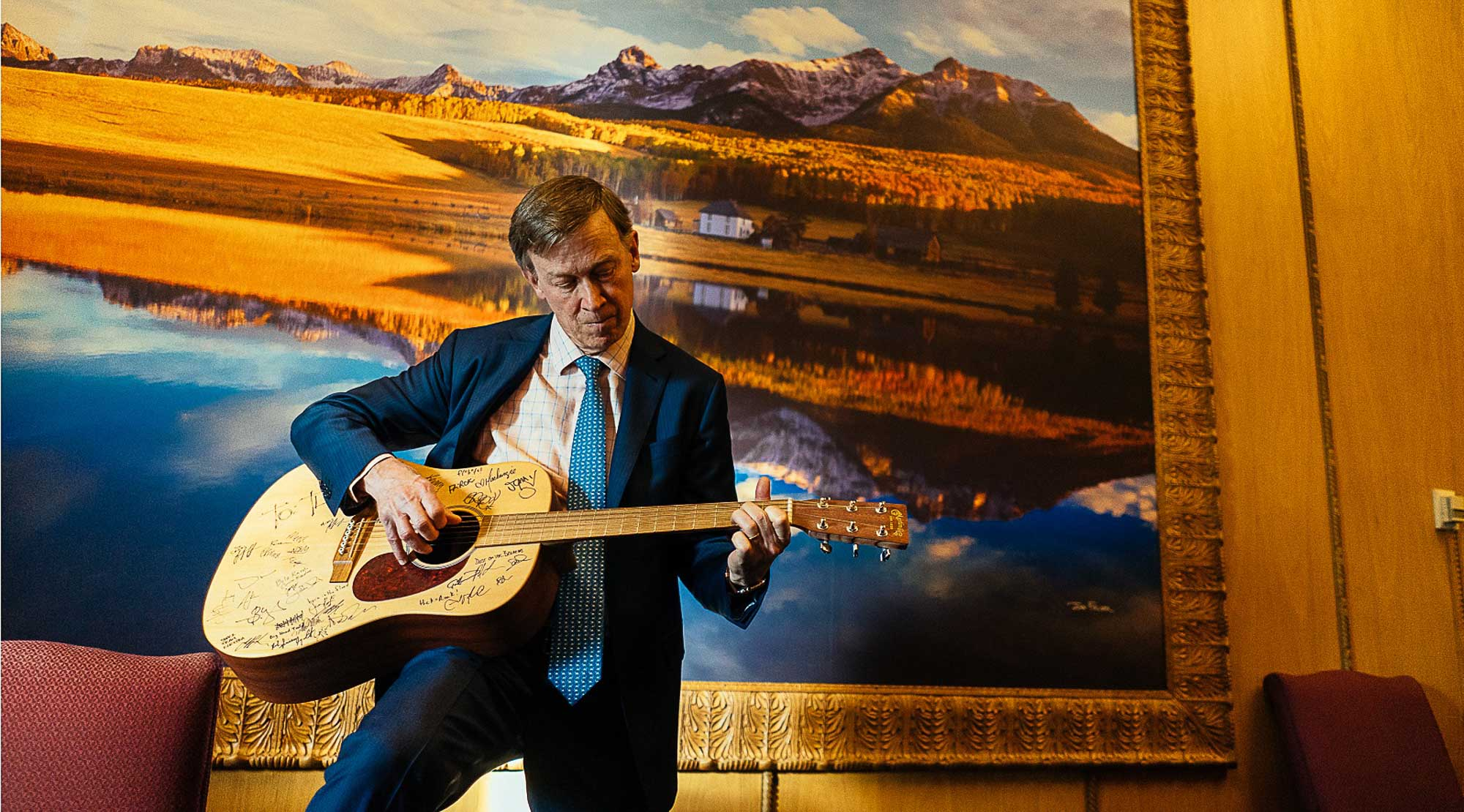 Governor John Hickenlooper plays his guitar.