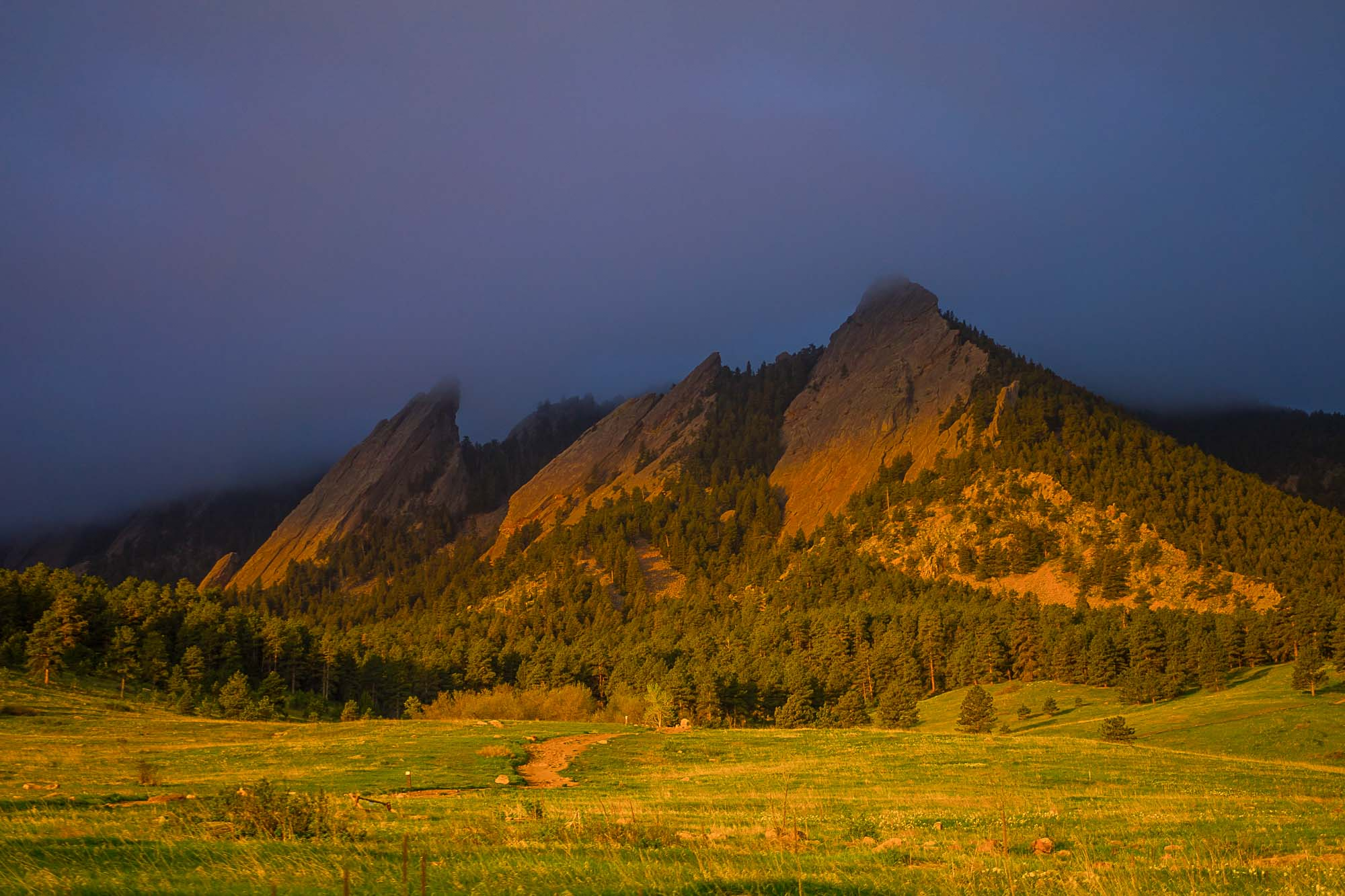 The Flatirons of Chautauqua in Boulder, Colorado as the sunsets.