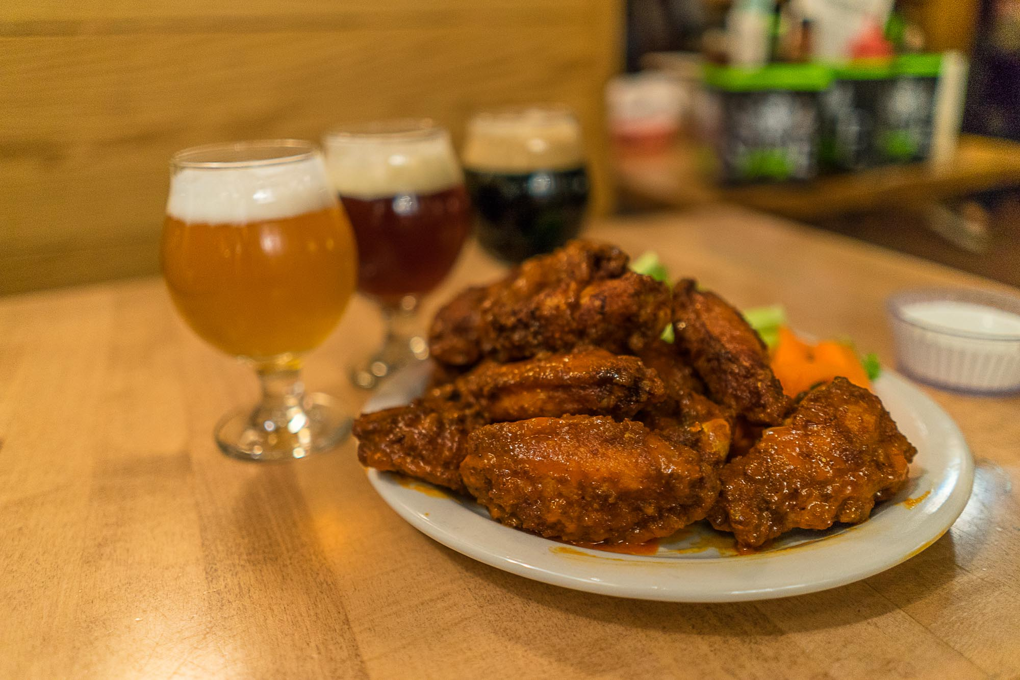 Chicken wings and three types of beer from Mountain Sun.