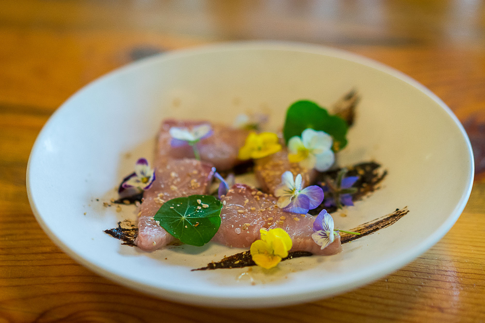 The Basta Crudo Plate. Market fresh fish, edible flowers from the garden.