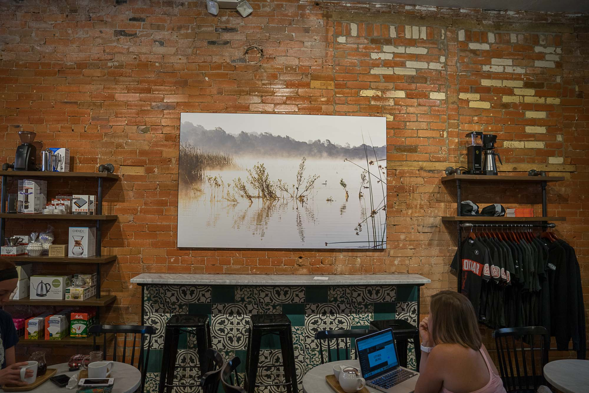 Art hanging on the walls at Boxcar Coffee Roasters in Boulder, Colorado.