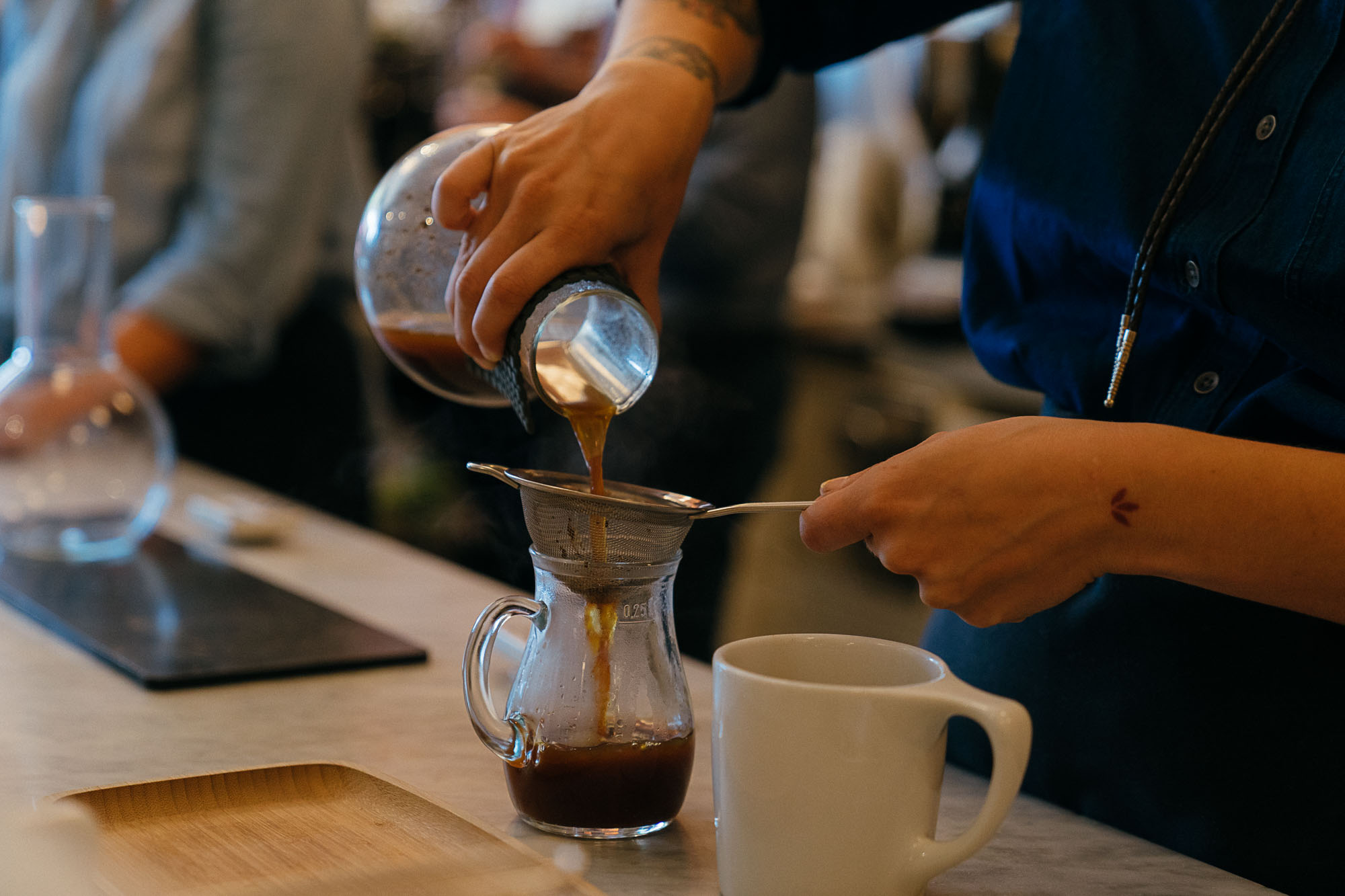 A pourover coffee at Boxcar Coffee Roasters in Boulder, Colorado as part of the Dirt Road Travels city guide.