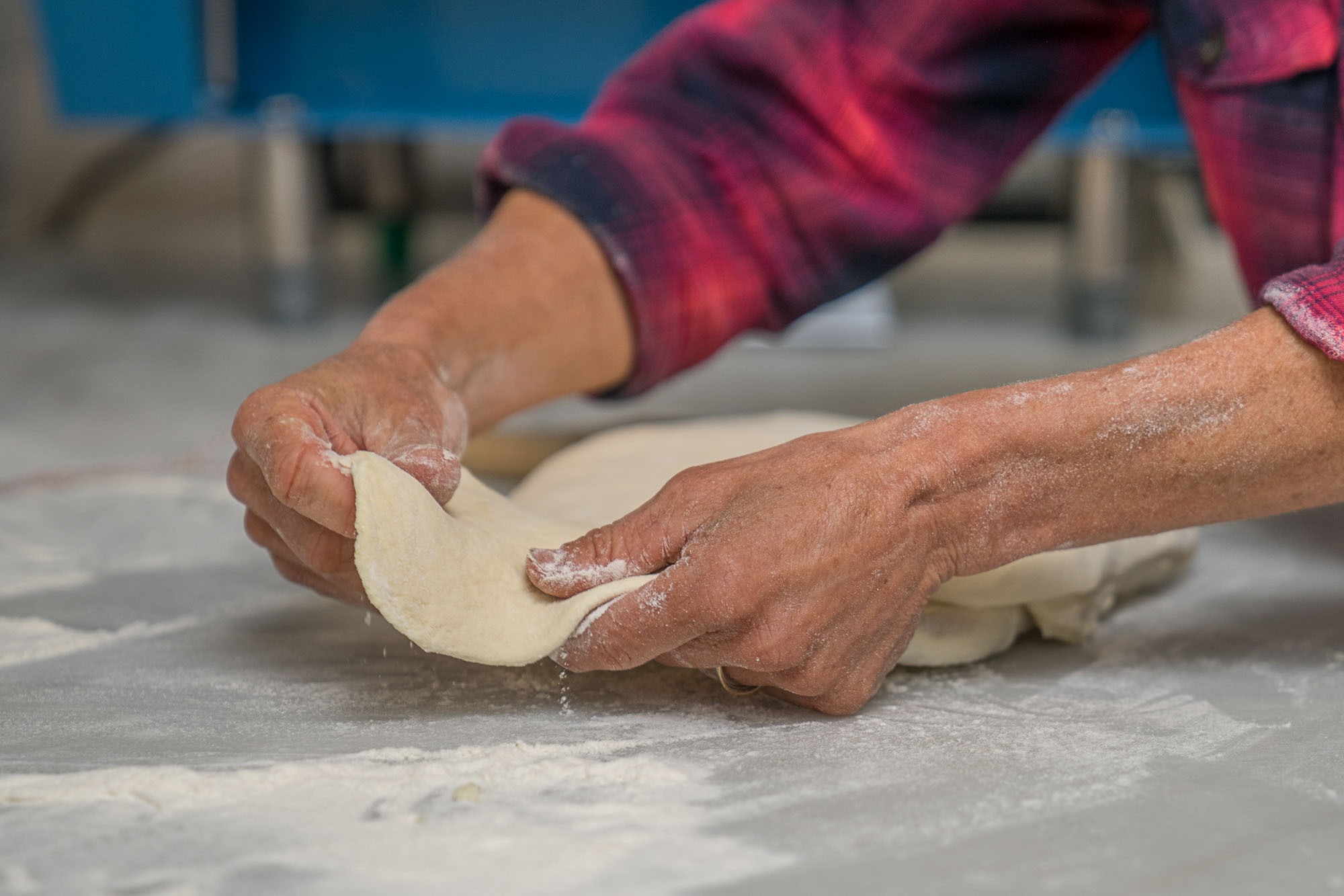 Dough being kneaded by hand at Boxcar Coffee Roasters in Boulder, Colorado.