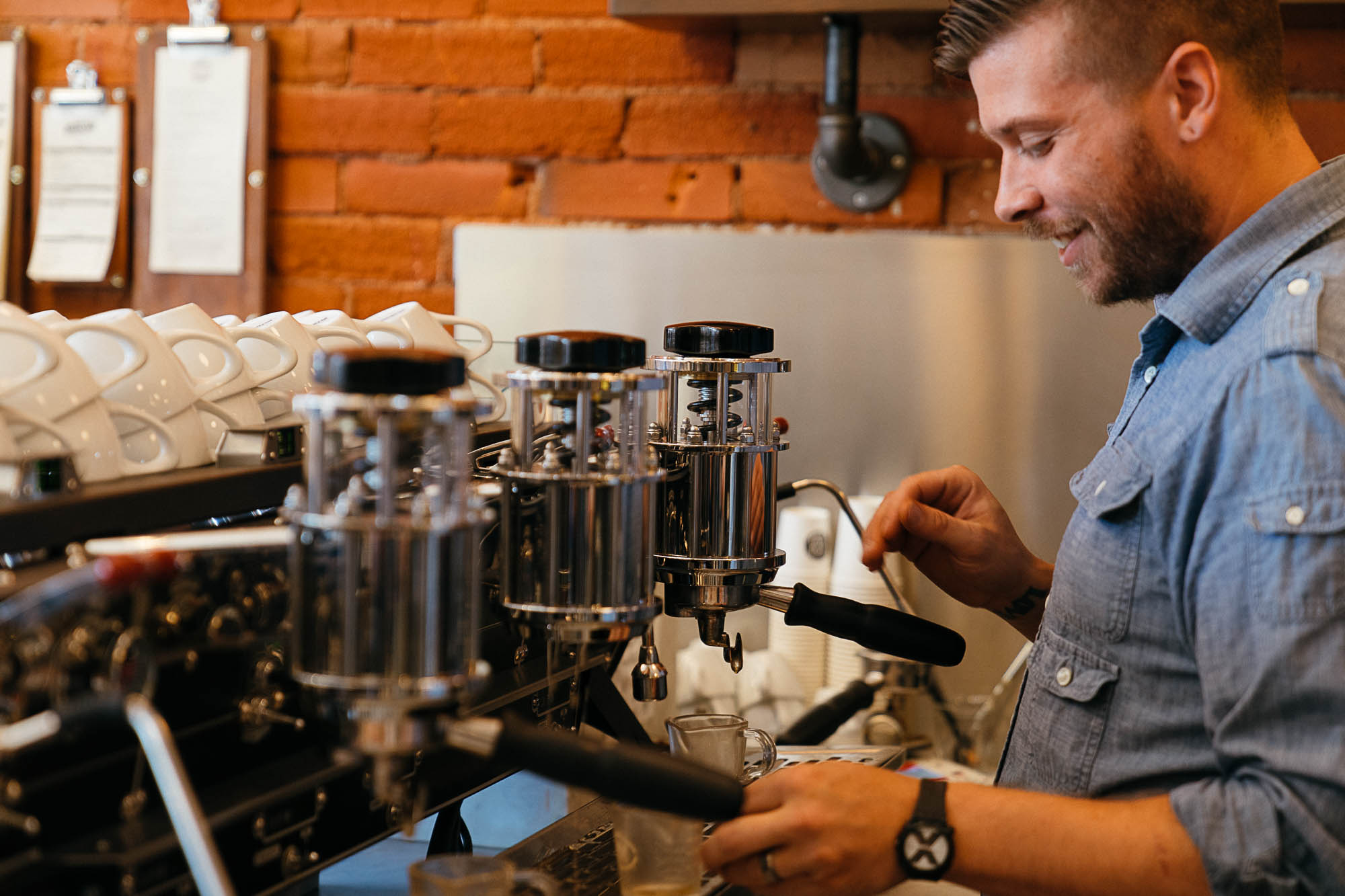 Brewing coffee at Boxcar Coffee Roasters in Boulder, CO as part of the Dirt Road Travels city guide.