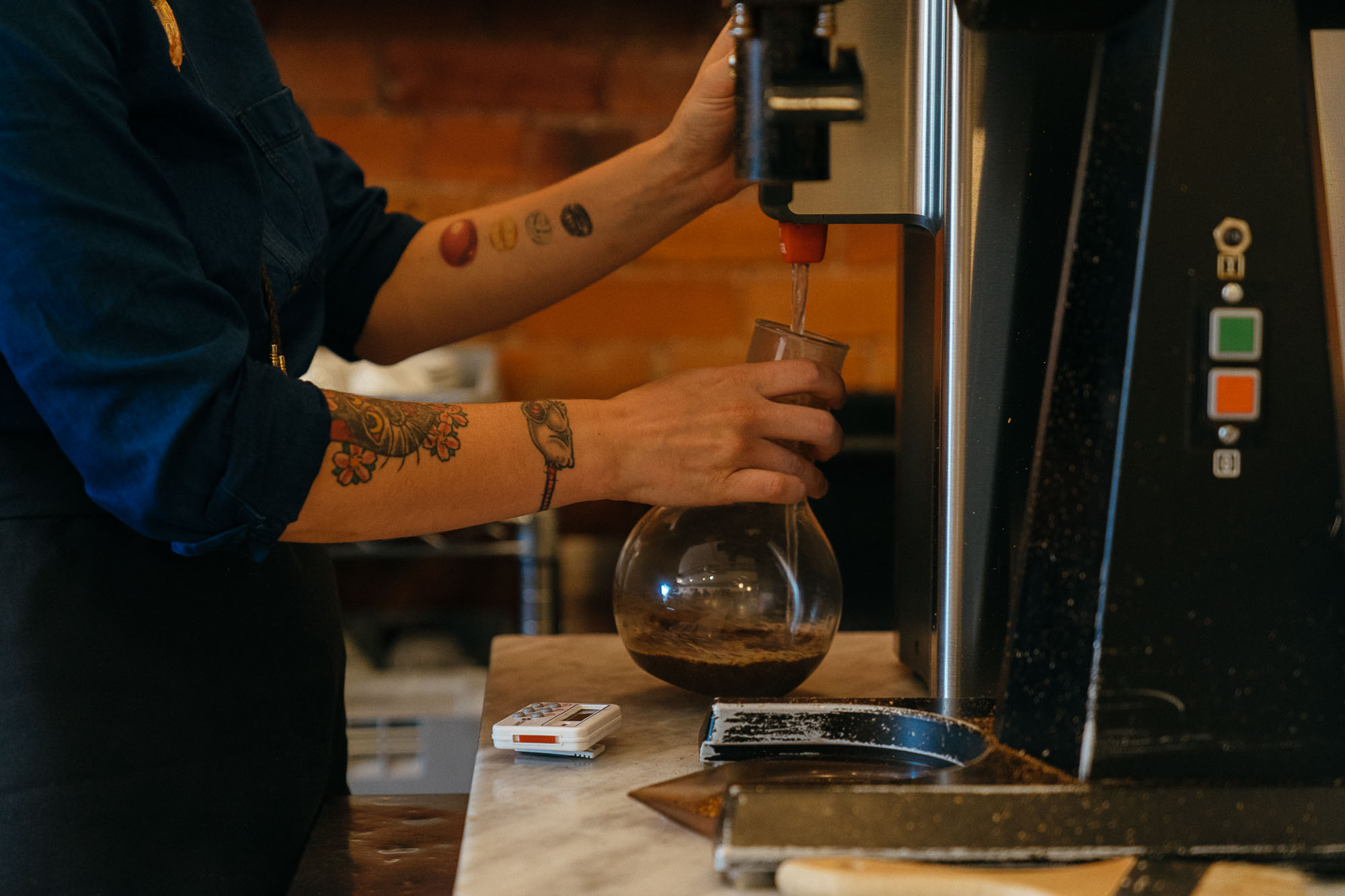 A barista adds warm water to coffee at Boxcar Coffee Roasters in Boulder, Colorado.