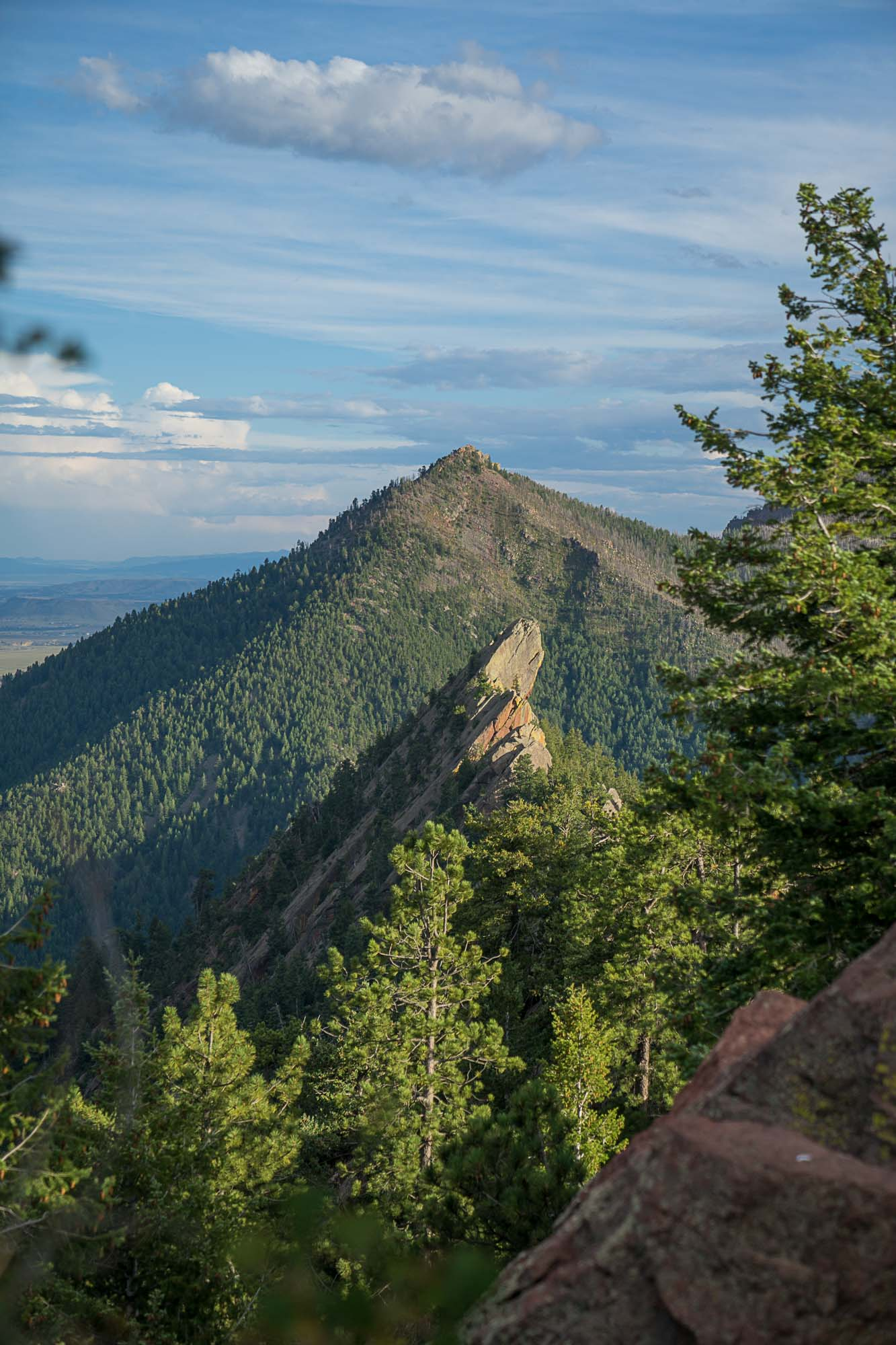 A view of the flatirons on the wya to green mountain in boulder colorado for dirt road travels