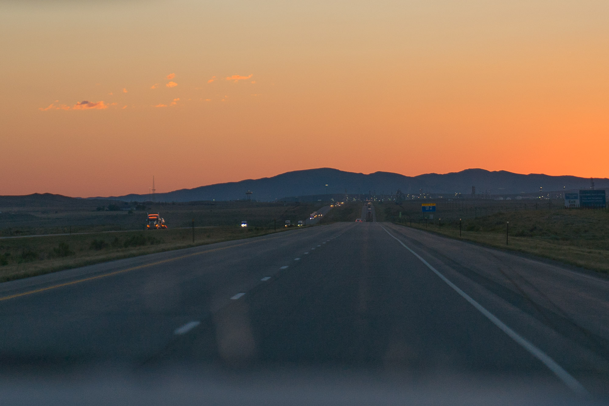 The sunset with beautiful orange and yellows over I-80 in Wyoming.