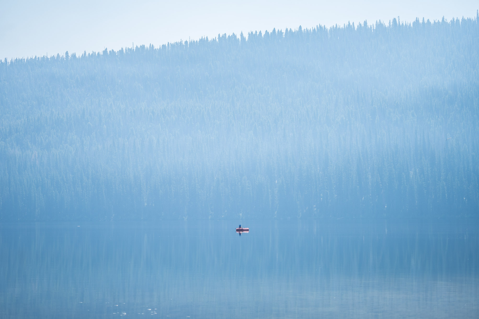 A woman on a boat on Stanley Lake.