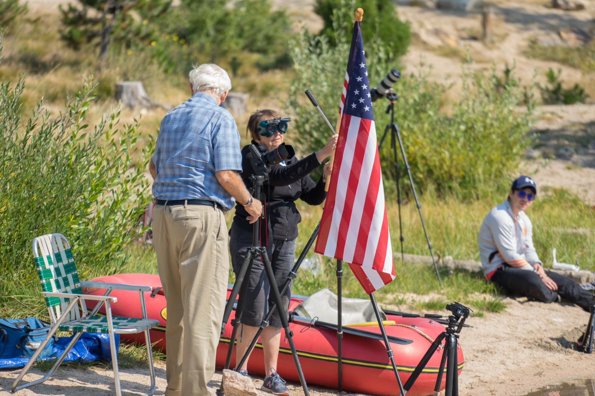 An elderly couple sets up for the eclipse on Stanley Lake.