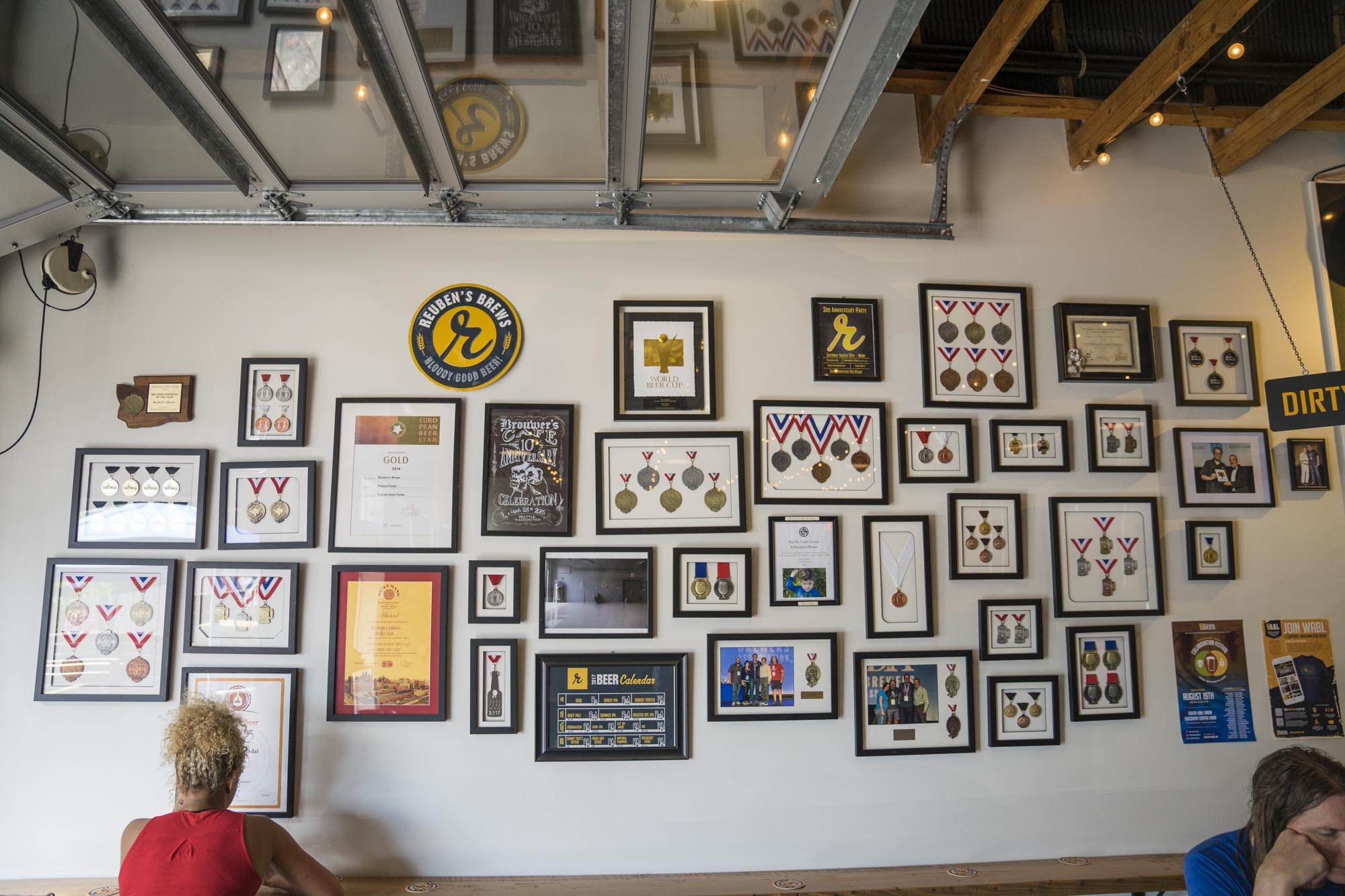 There are lots of medals on the wall from winning homebrew compeitions at Reuben's Brews in Seattle.