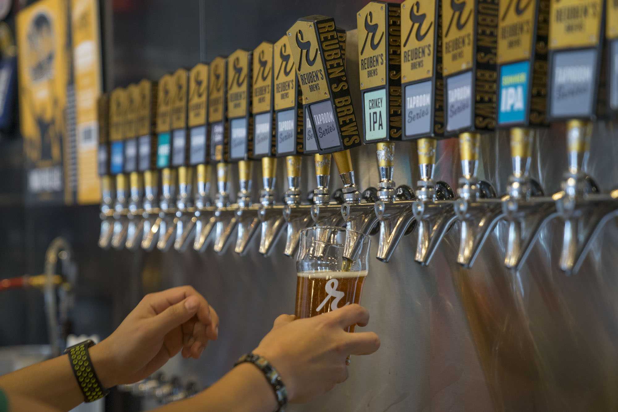 A beer is poured at Reuben's Brews in Seattle.
