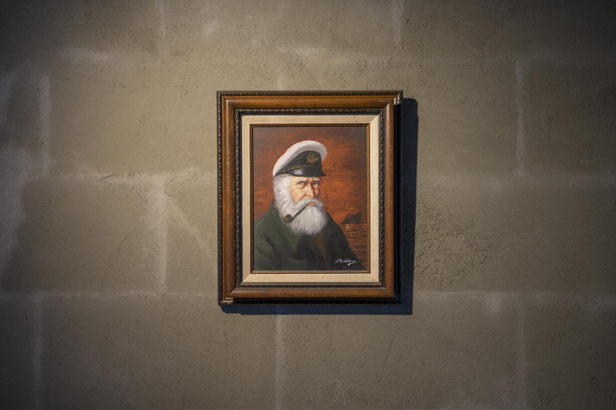 A frame of a captain looks out at diners at Westward in Seattle.