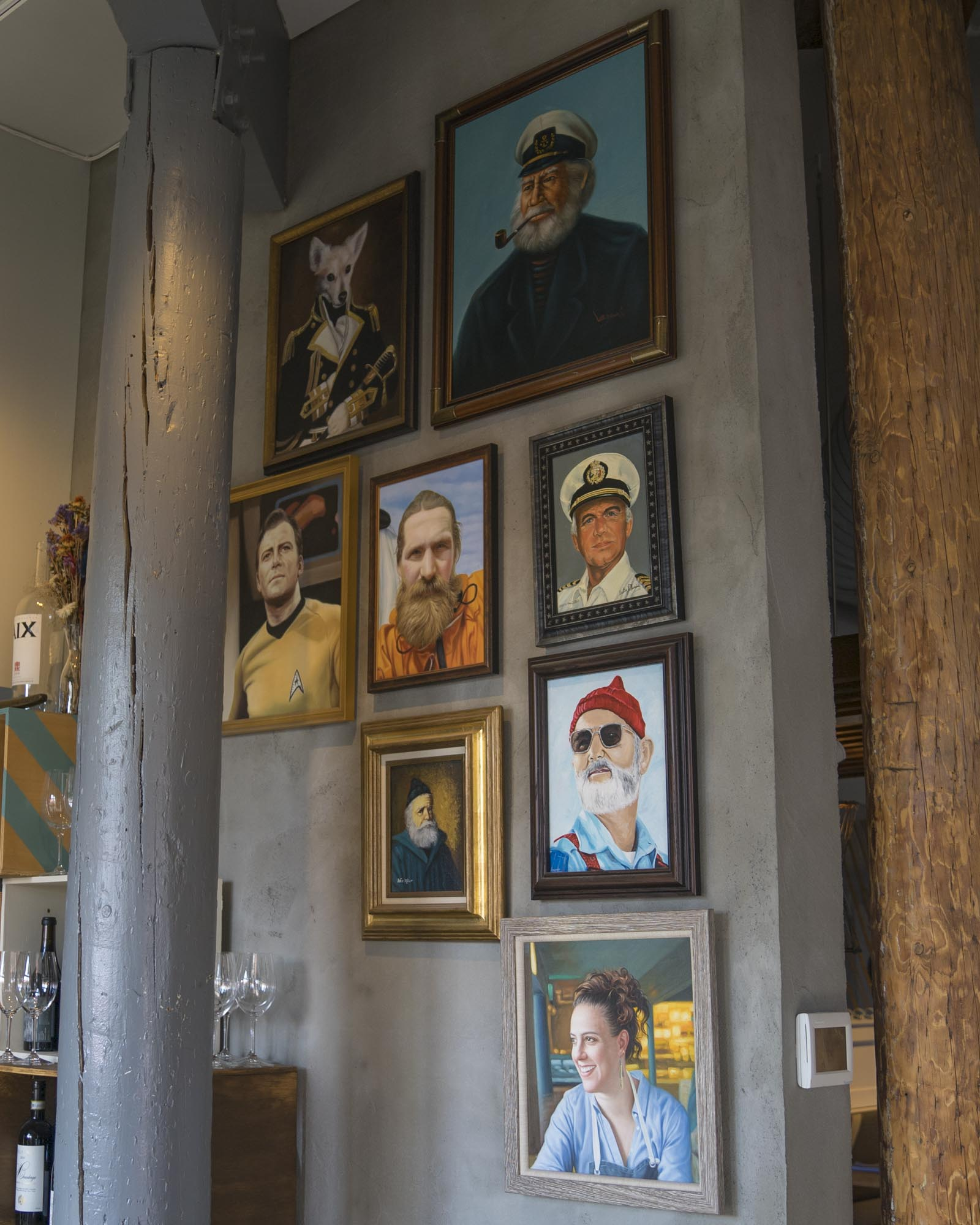 A few paintings of famous sailors and captains at Westward in Seattle.