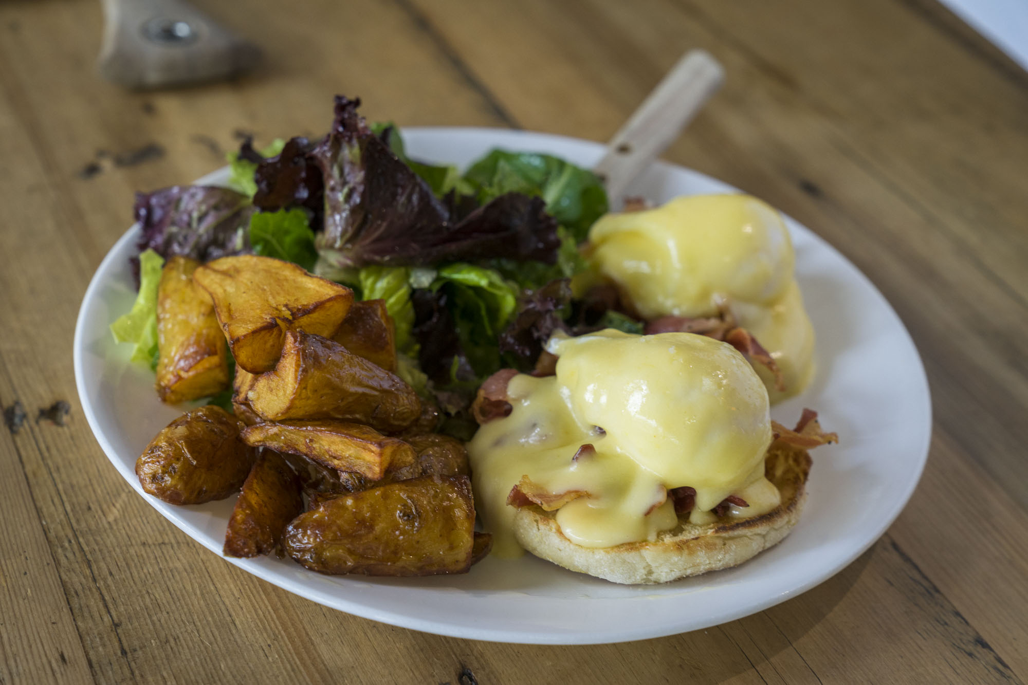 The Eggs Benedict with salad and fries at The Fat Hen in Seattle.