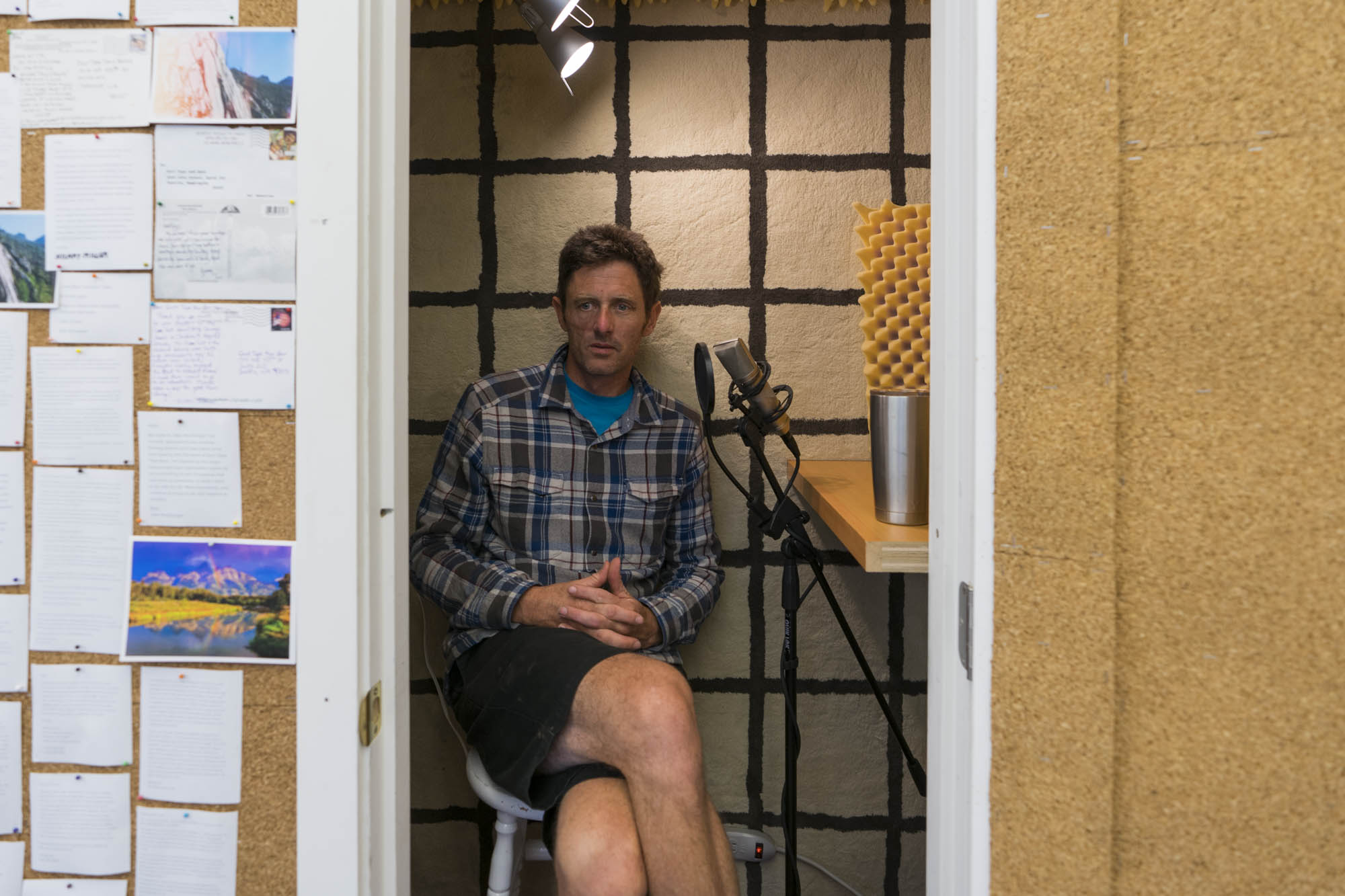Fitz sits in the recording studio for The Dirtbag Diaries at the headquarters of Duct Tape Then Beer in Seattle.