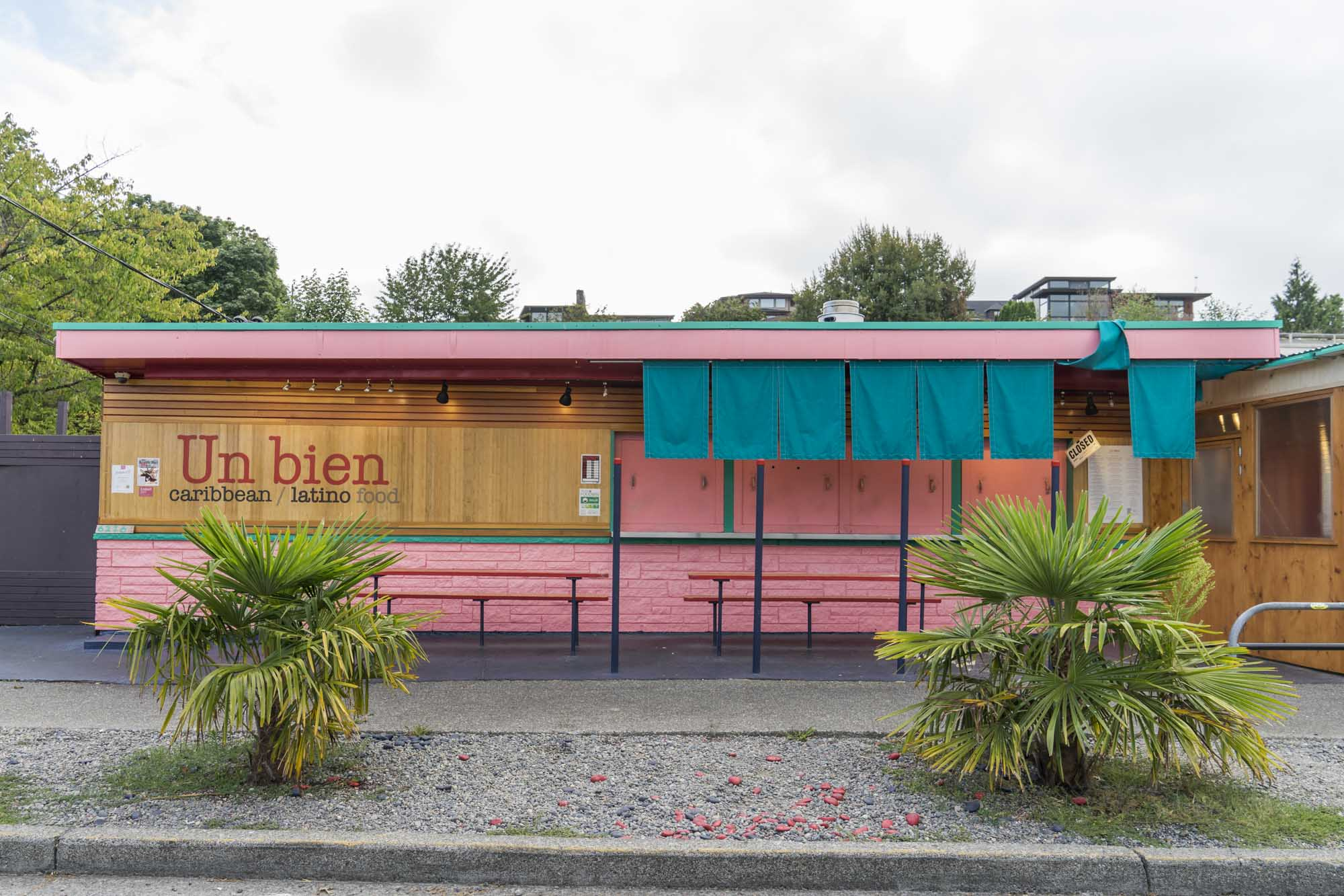 The outside pink and blue and green facad of Un Bien in Seattle.