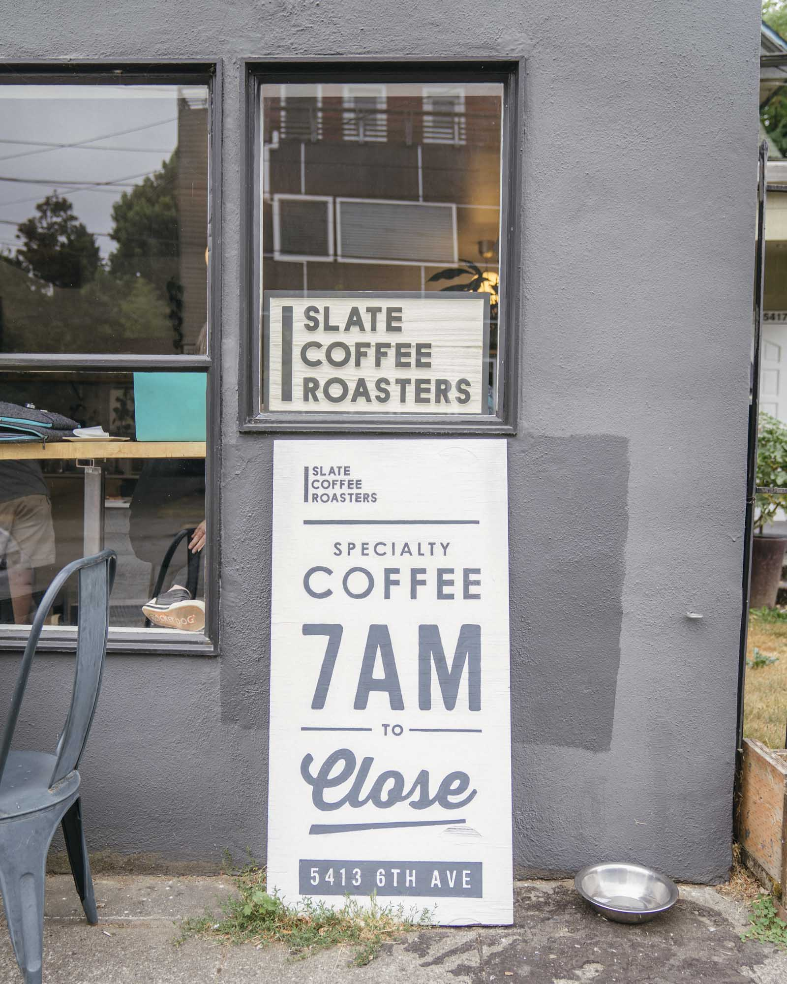 The signs outside of Slate Coffee Roasters in Seattle.