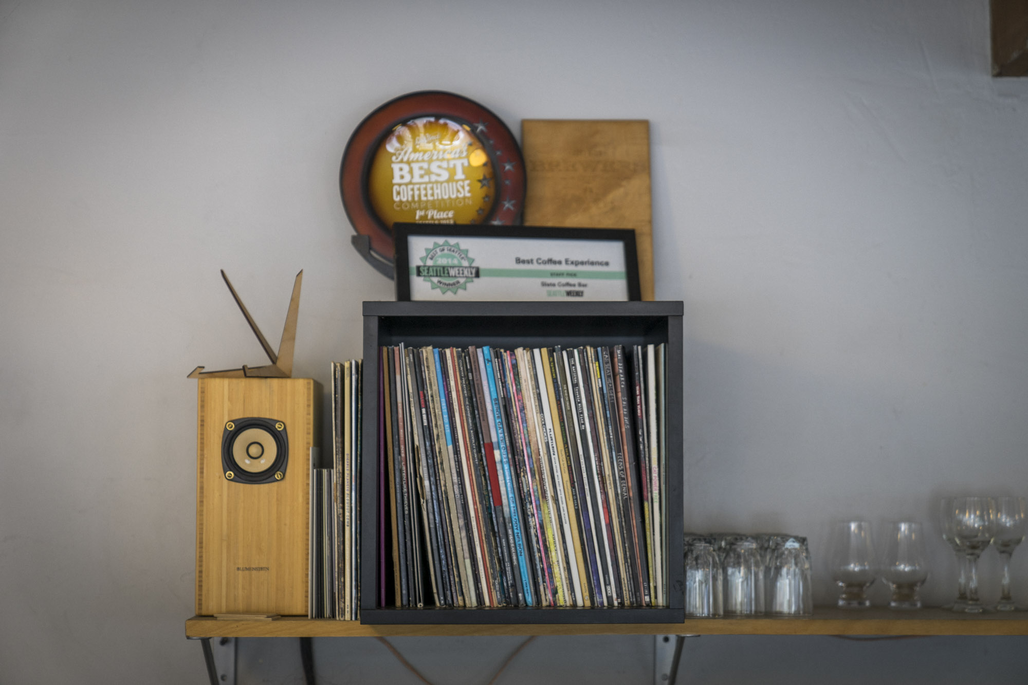 The inside of Slate Coffee Roasters has records, glasses and vintage goods on the wall.