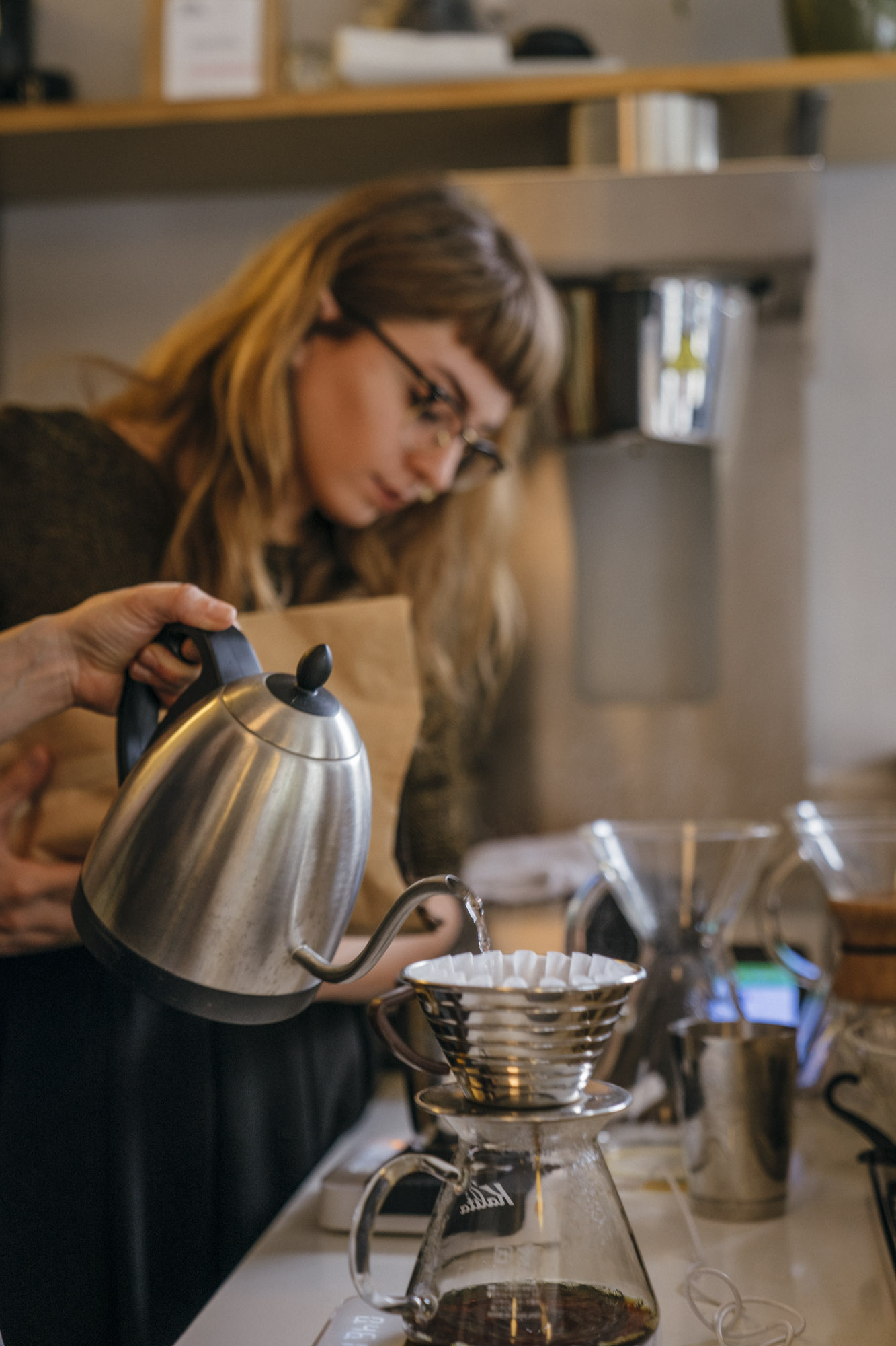 Chelsey Walker-Watson makes a pour over at Slate Coffee in Seattle.