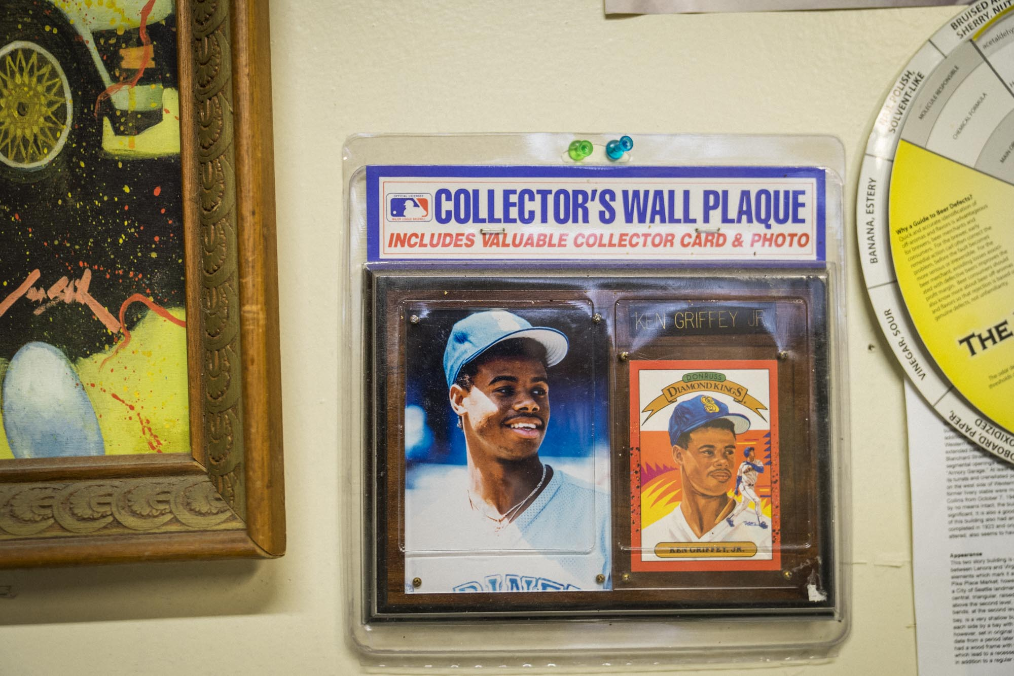 A Ken Griffey Jr. baseball card on the wall at Cloudburst in Seattle.