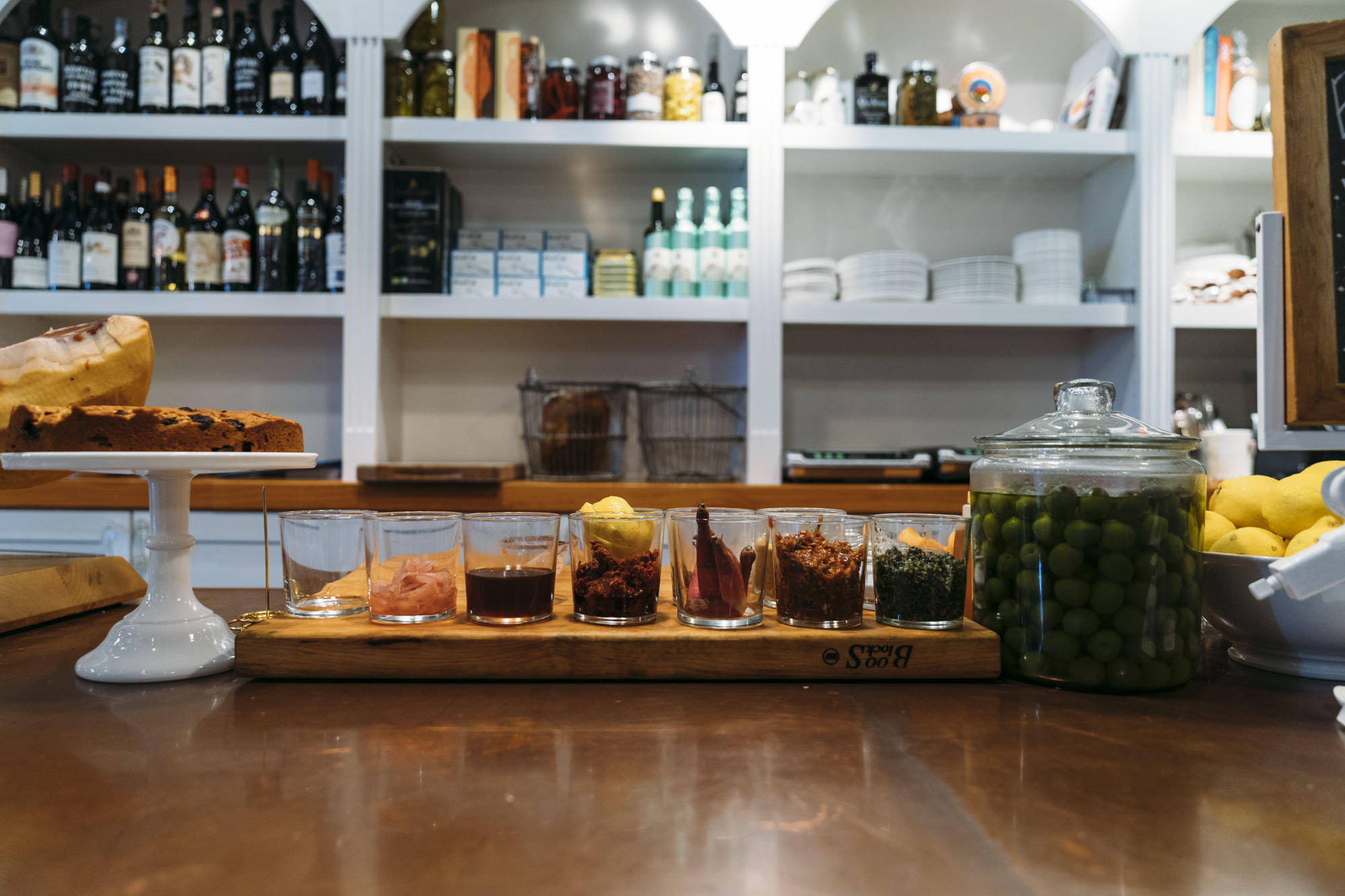 The Barnacle in Seattle's counter has olives, lemons, glasses and drinks.