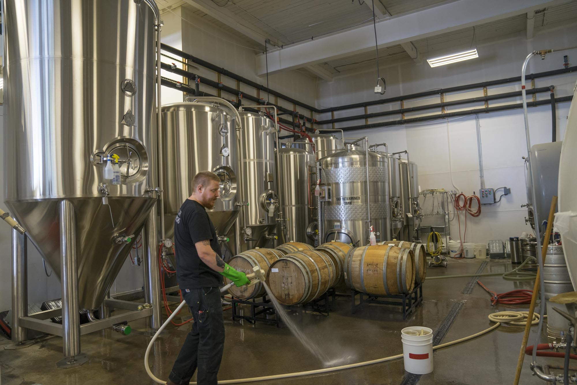 A brewer cleans kegs at Holy Mountain in Seattle.