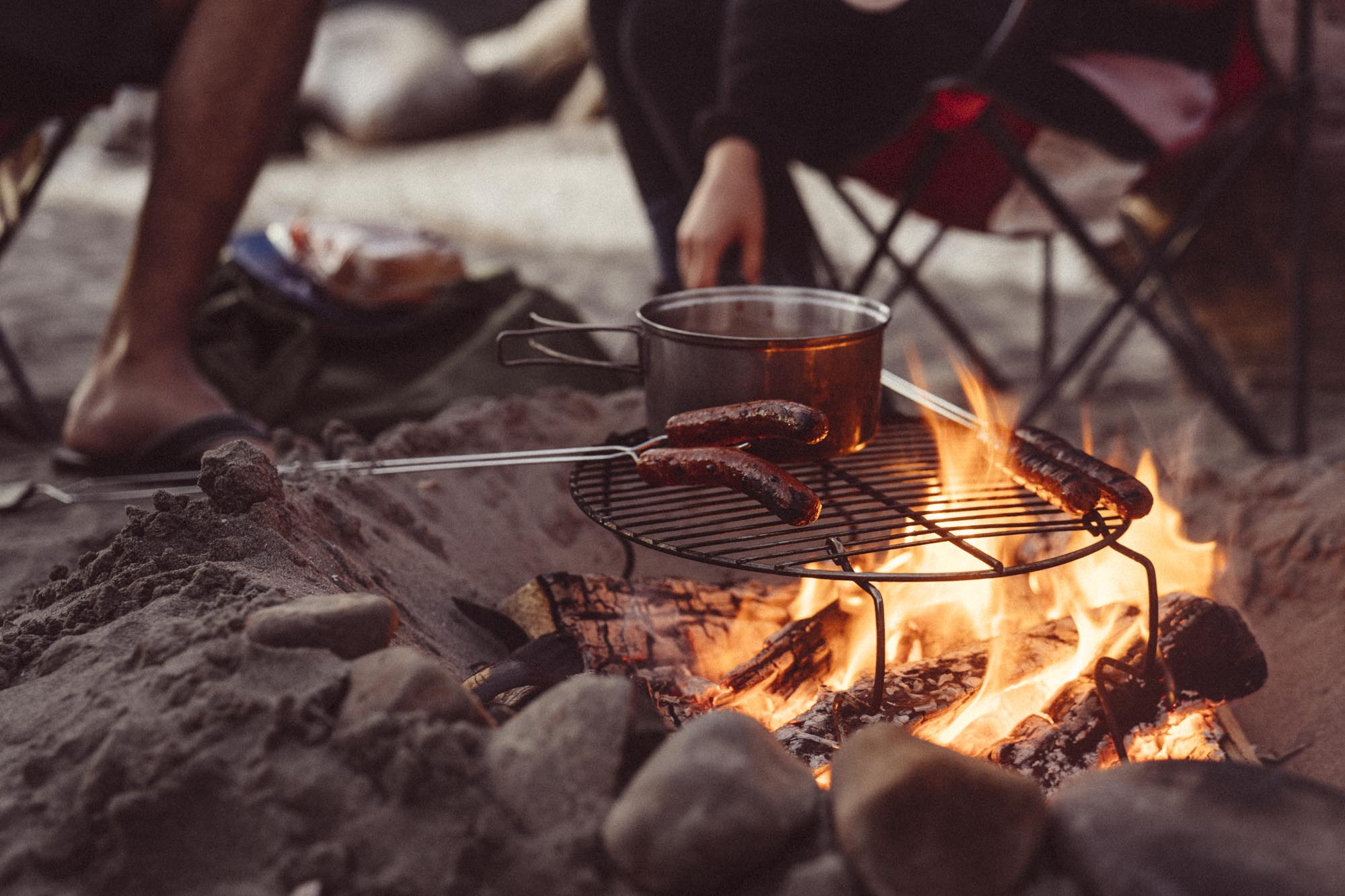People cook hot dogs in Olympic National Park.