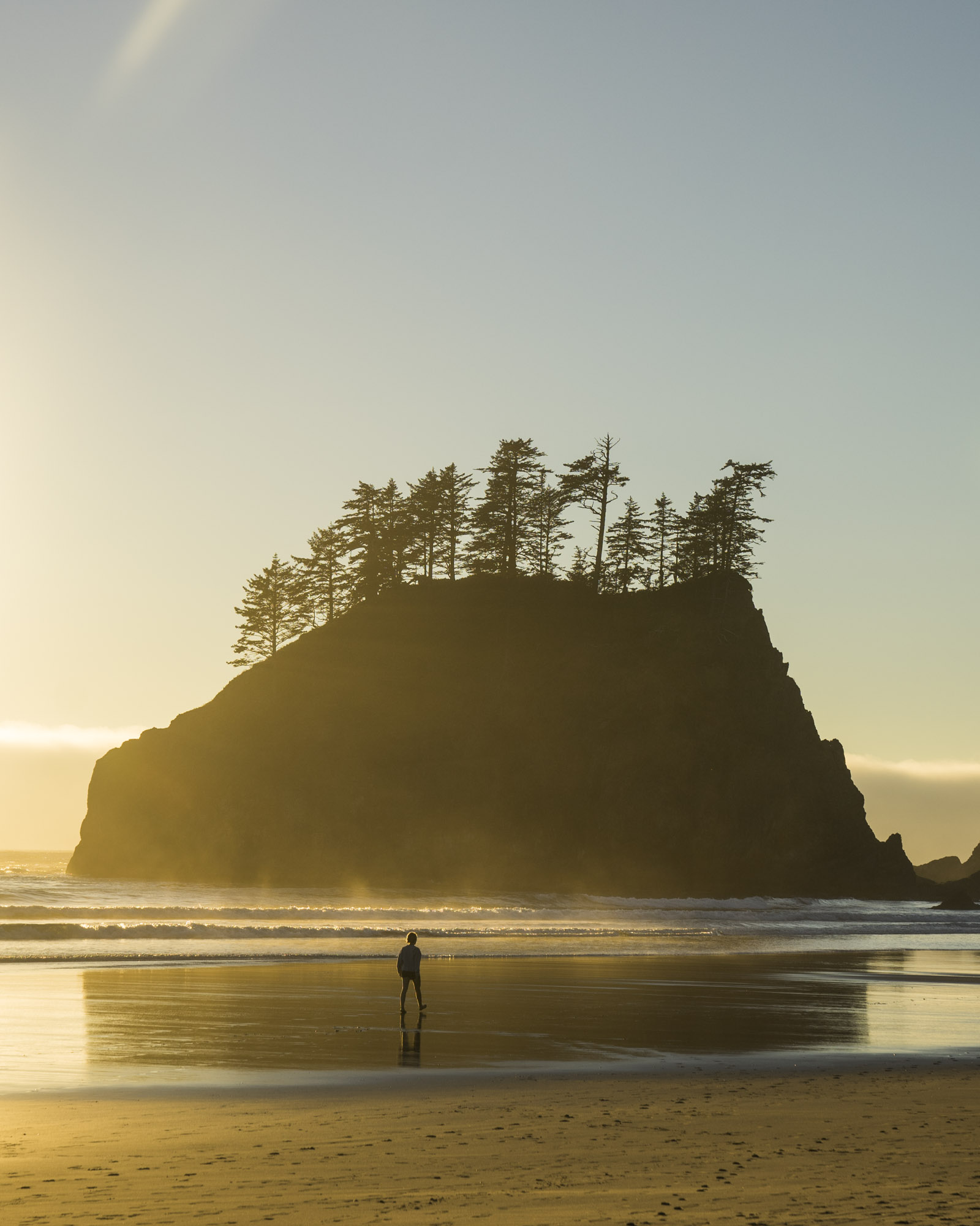 Person walks along Second Beach in Olympic National Park.
