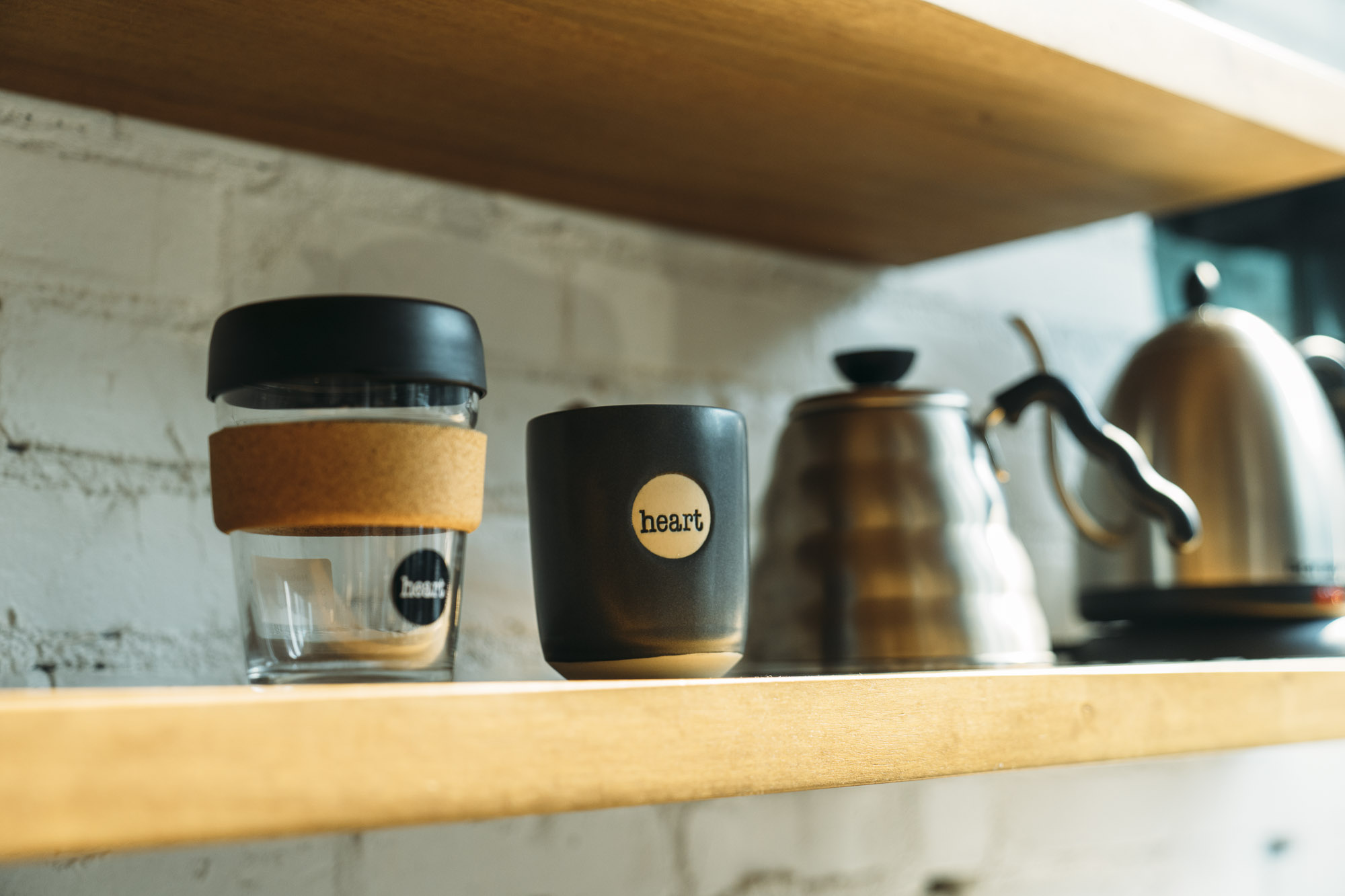 Coffee Cups and mugs on a shelf at Heart in portland for Dirt Road Travels
