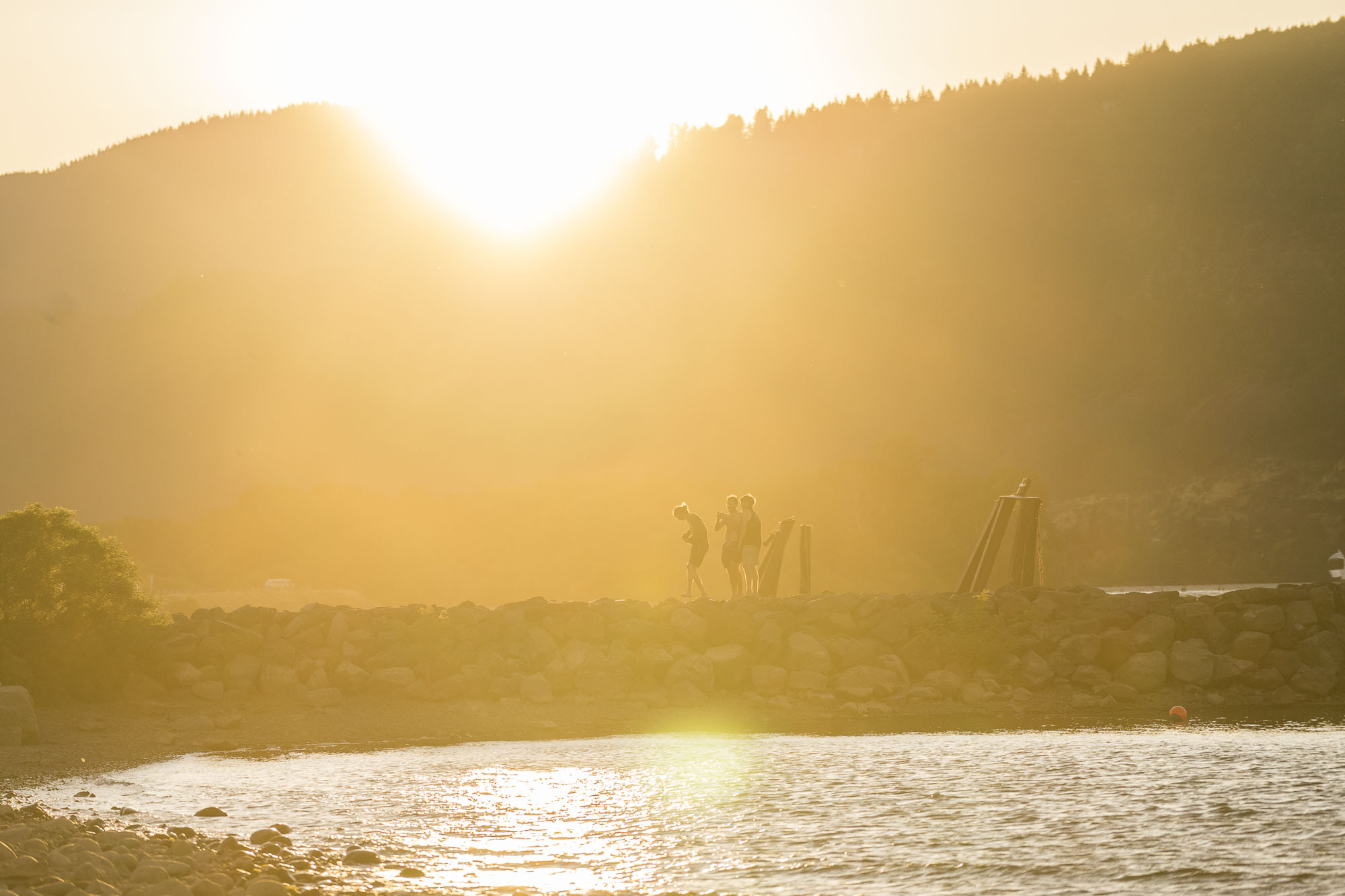A few surfers look out on the Columbia River in Hood River, OR.