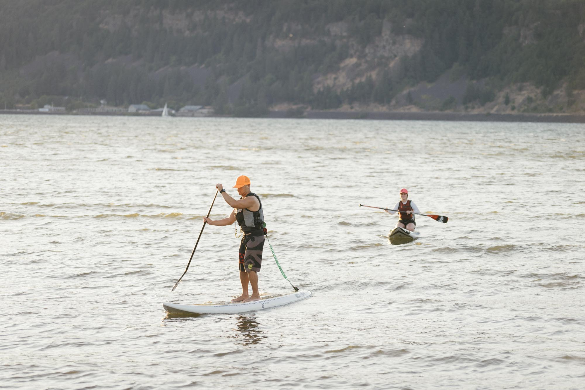 A few paddle boarders head out on the Columbia River in Hood River, Oregon.
