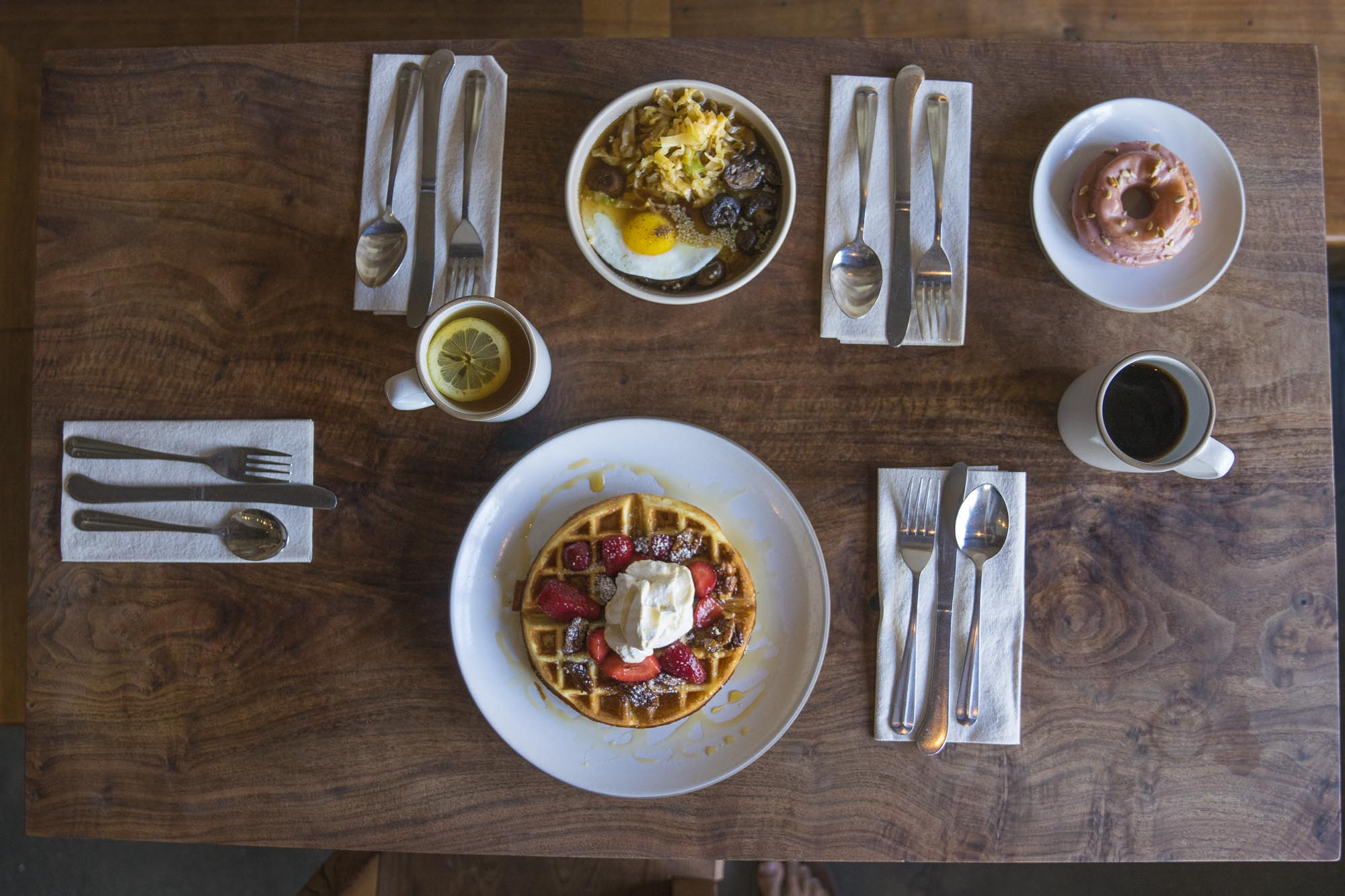 A breakfast spread of food at outerland in San Francisco for Dirt Road Travels